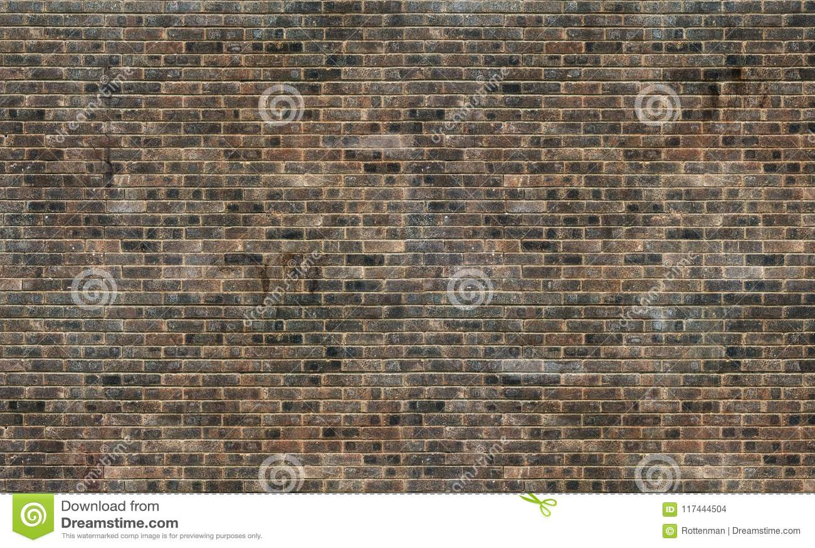 Vieux fond brun grunge de texture de mur de briques