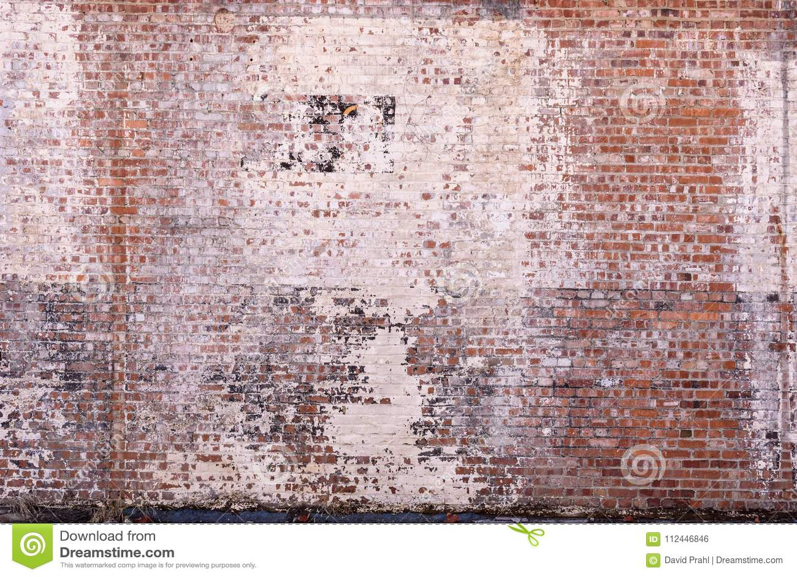 Vieux mur de briques avec la peinture fané et d épluchage