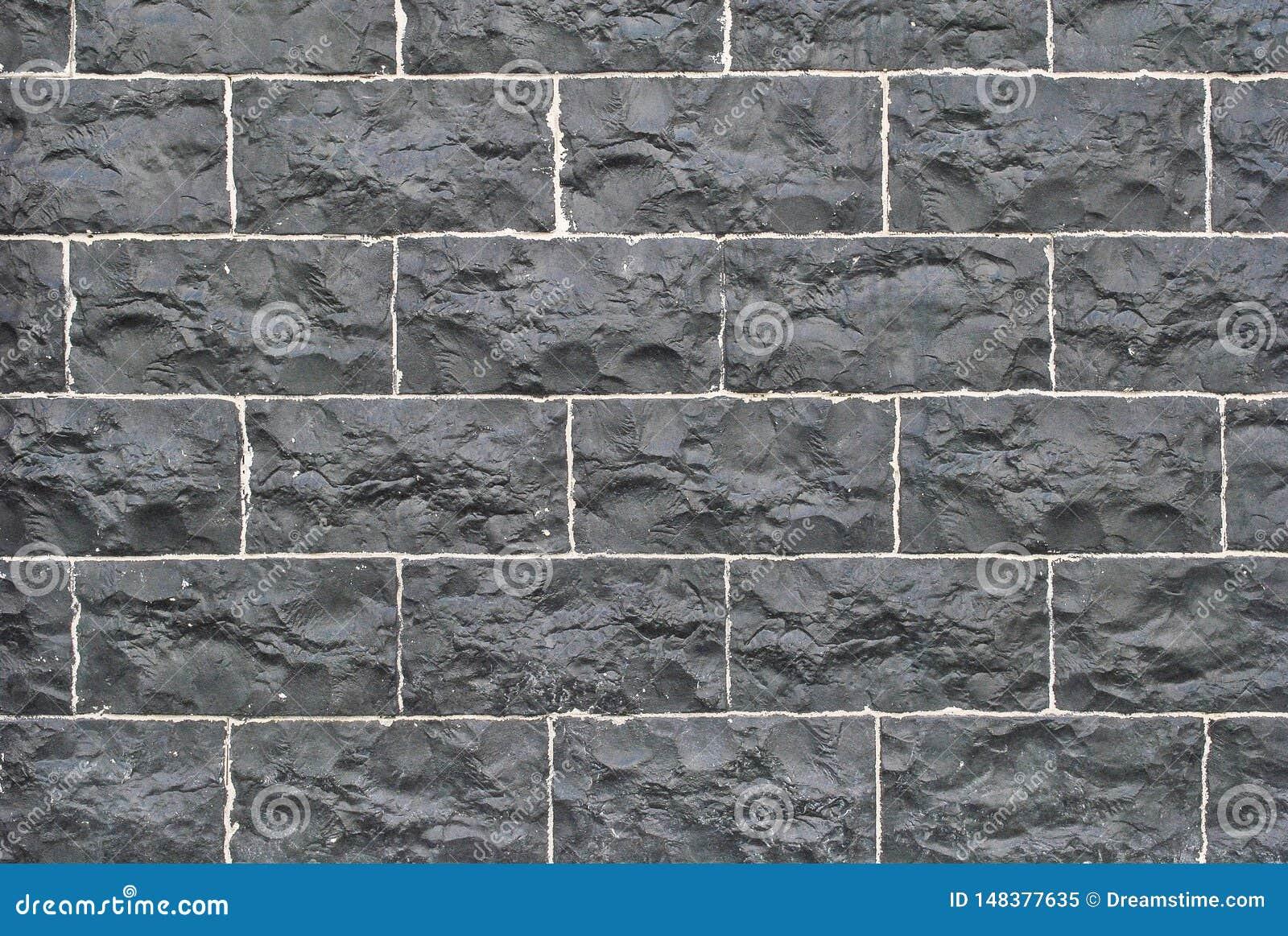 Vieux mur en pierre taillé, belle texture de fond