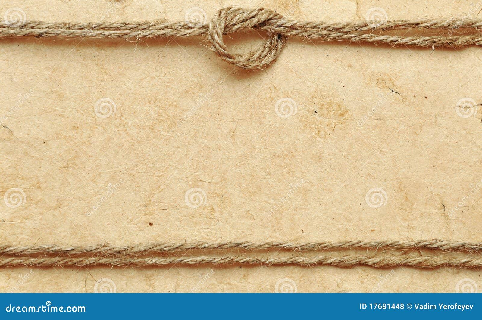 Vieux papier avec la corde