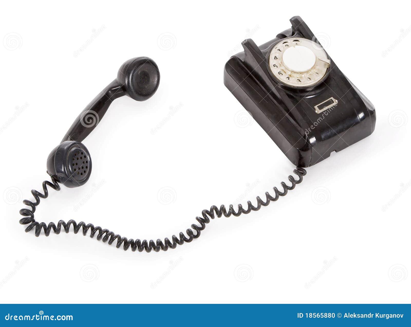 Vieux téléphone noir d isolement au-dessus du blanc