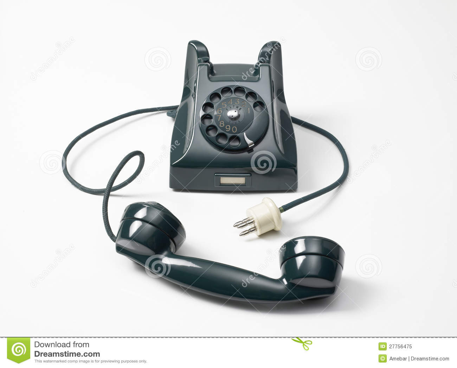 Vieux téléphone vert sur un fond blanc