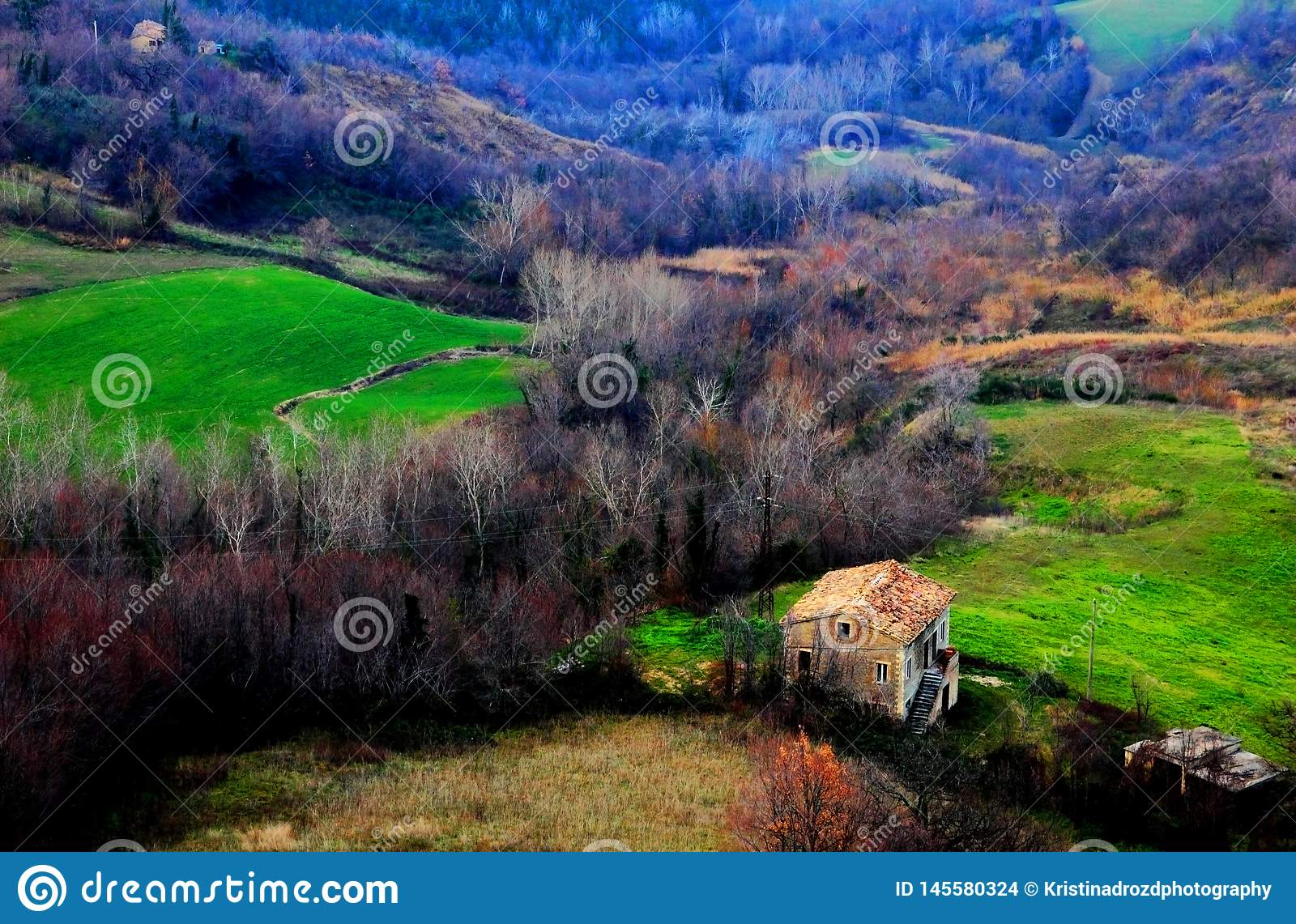 View from above at an house, forests and fields