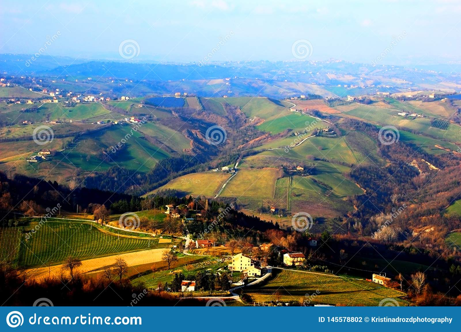 View from above at Marche hills covered by fields and forests