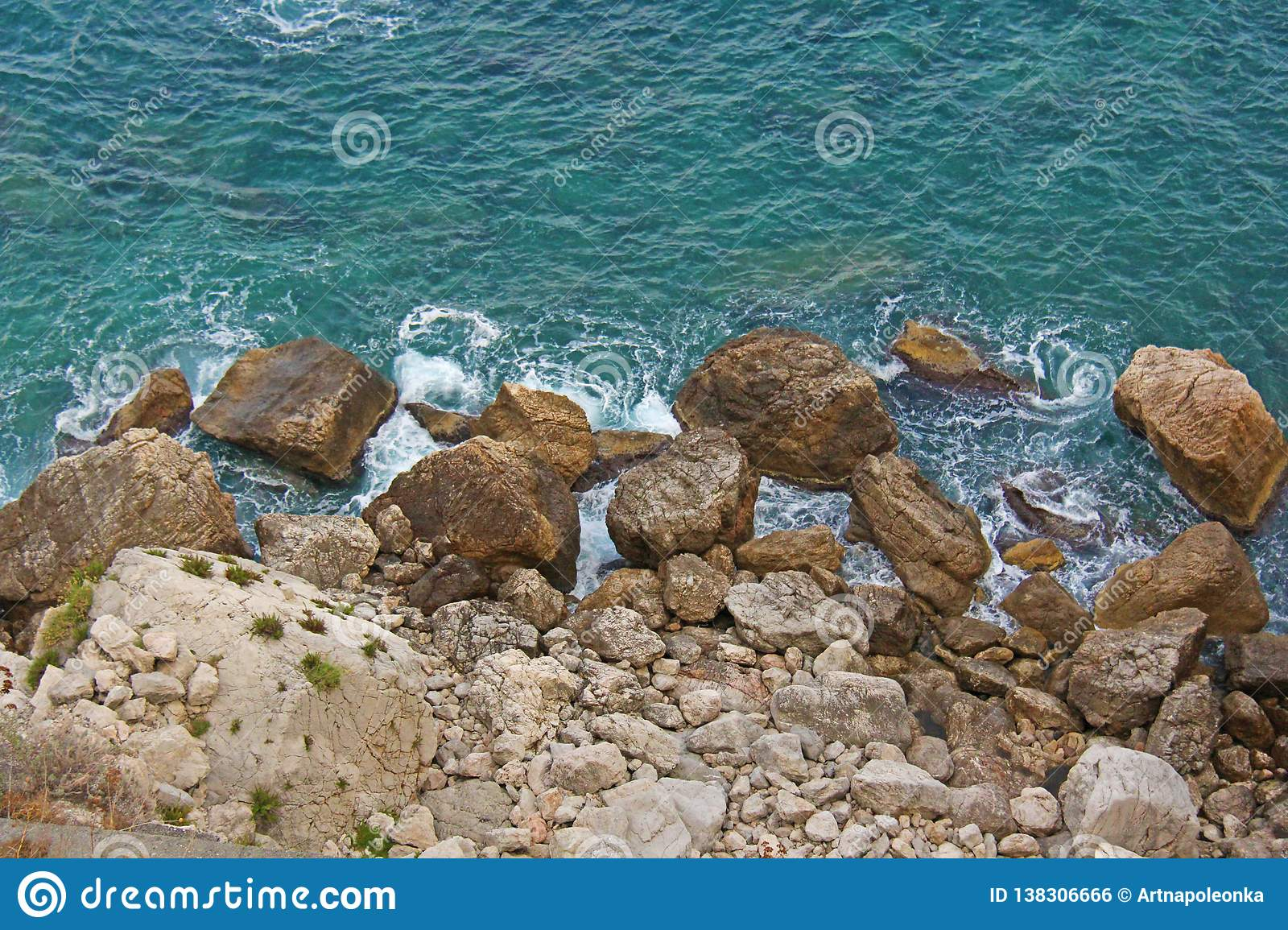 View from Above on the Sea and Stones or Rocks in the City of Taormina. The island of Sicily, Italy. Beautiful and Scenic View of