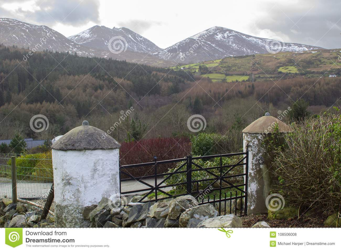 A view across one of the many snow topped hills and valleys of the Mourne Mountains in County down in Northern Ireland on a dull m