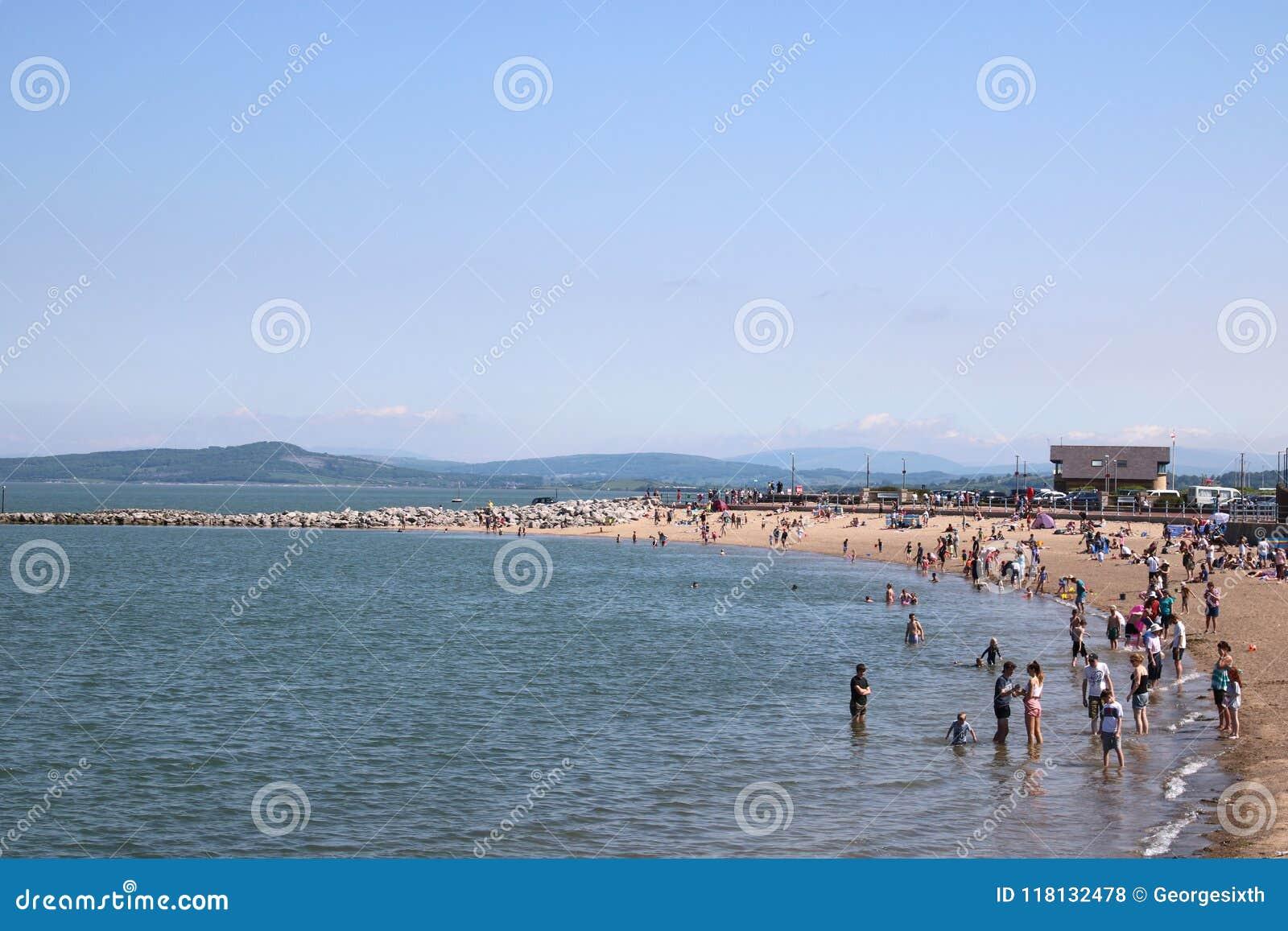 People on beach, sunny day, Morecambe, Lancashire