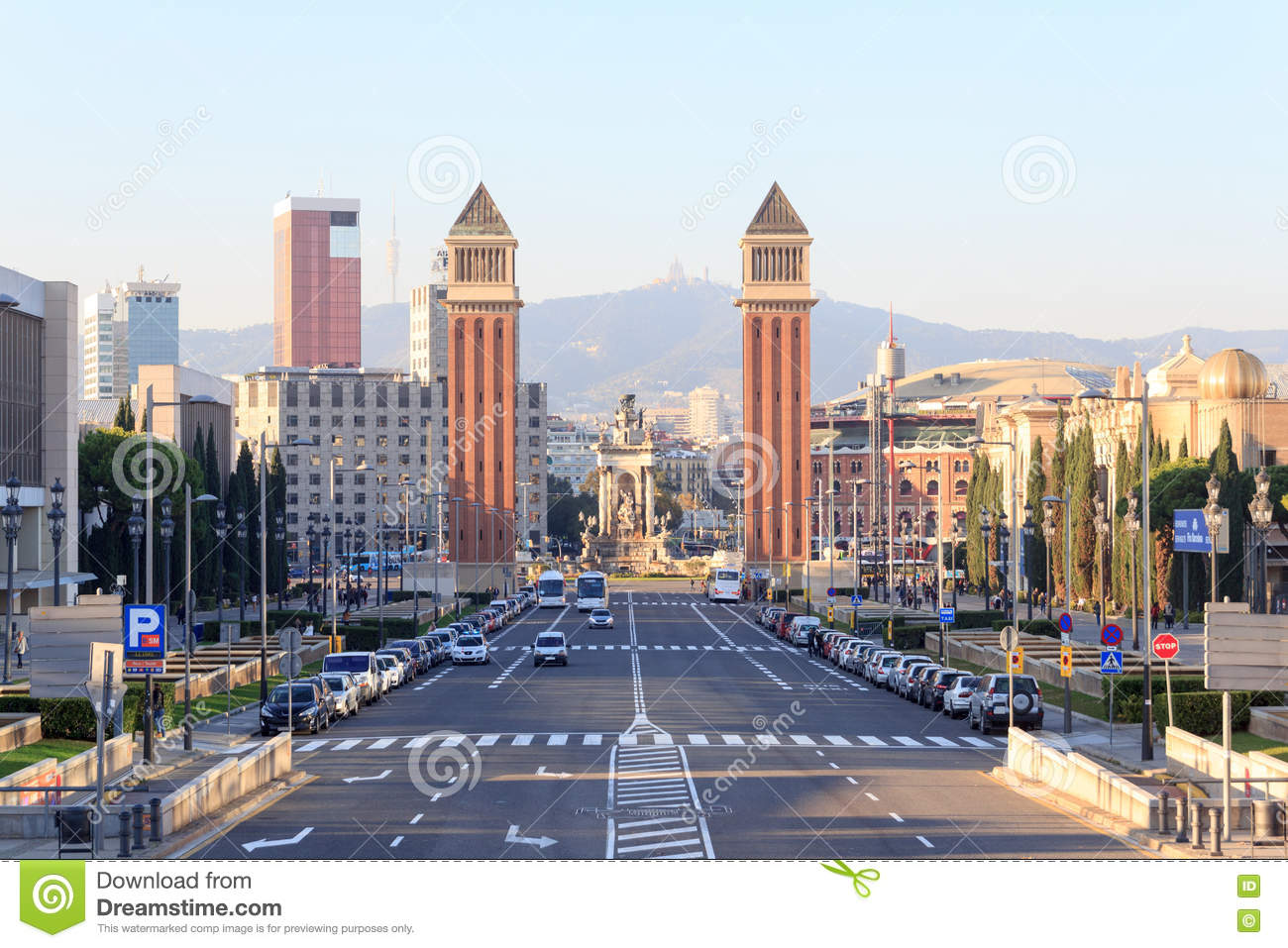 View along street towards square Placa d Espanya and Venetian towers in Barcelona