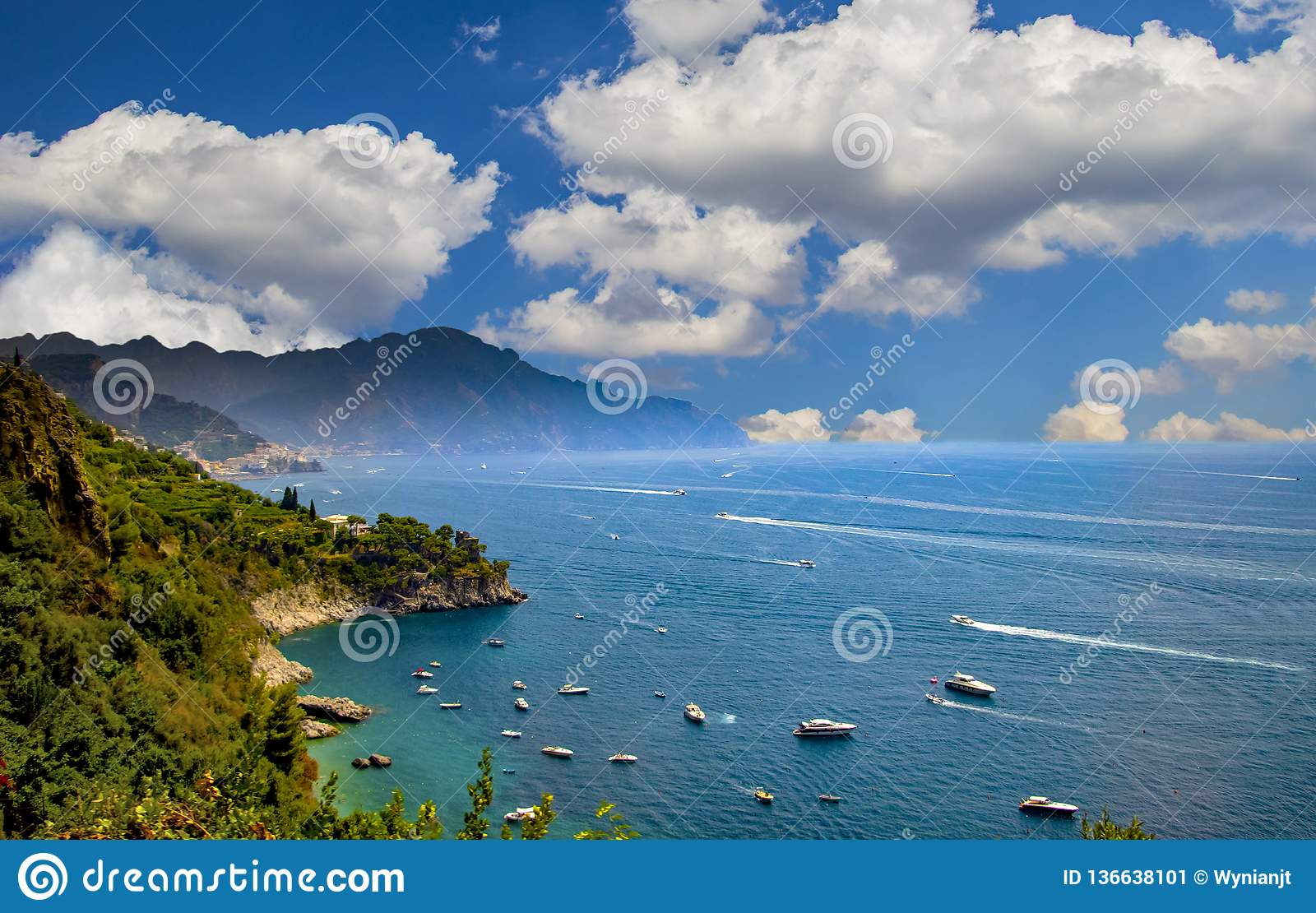 The view of Amalfi coast. This is on the south of Italy in Europe. The city stands on cliffs above the sea. There are boats on the