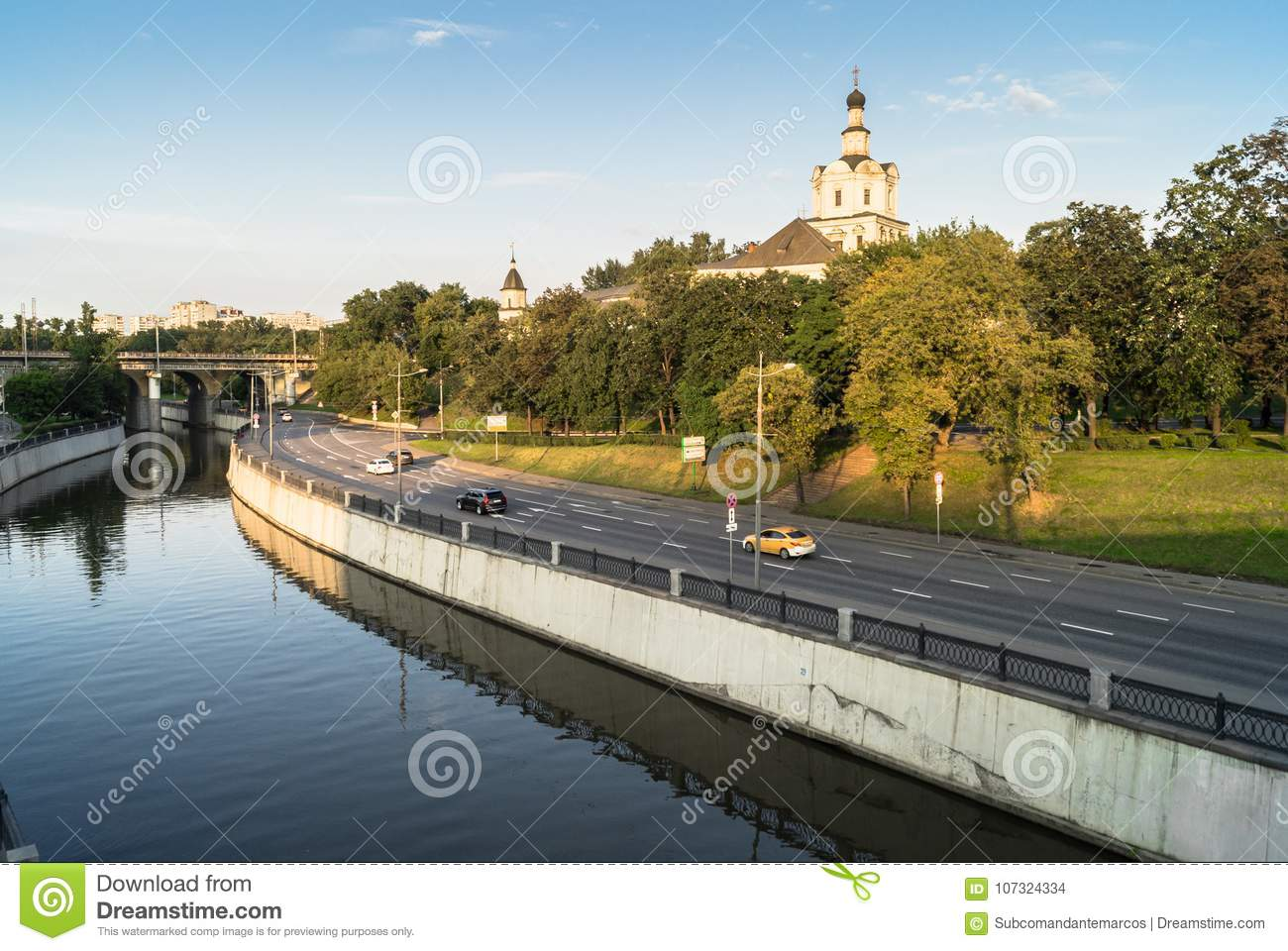 View of the Andronikov Monastery and roadway of the river Yauza quay on the clear summer evening, Moscow, Russia.