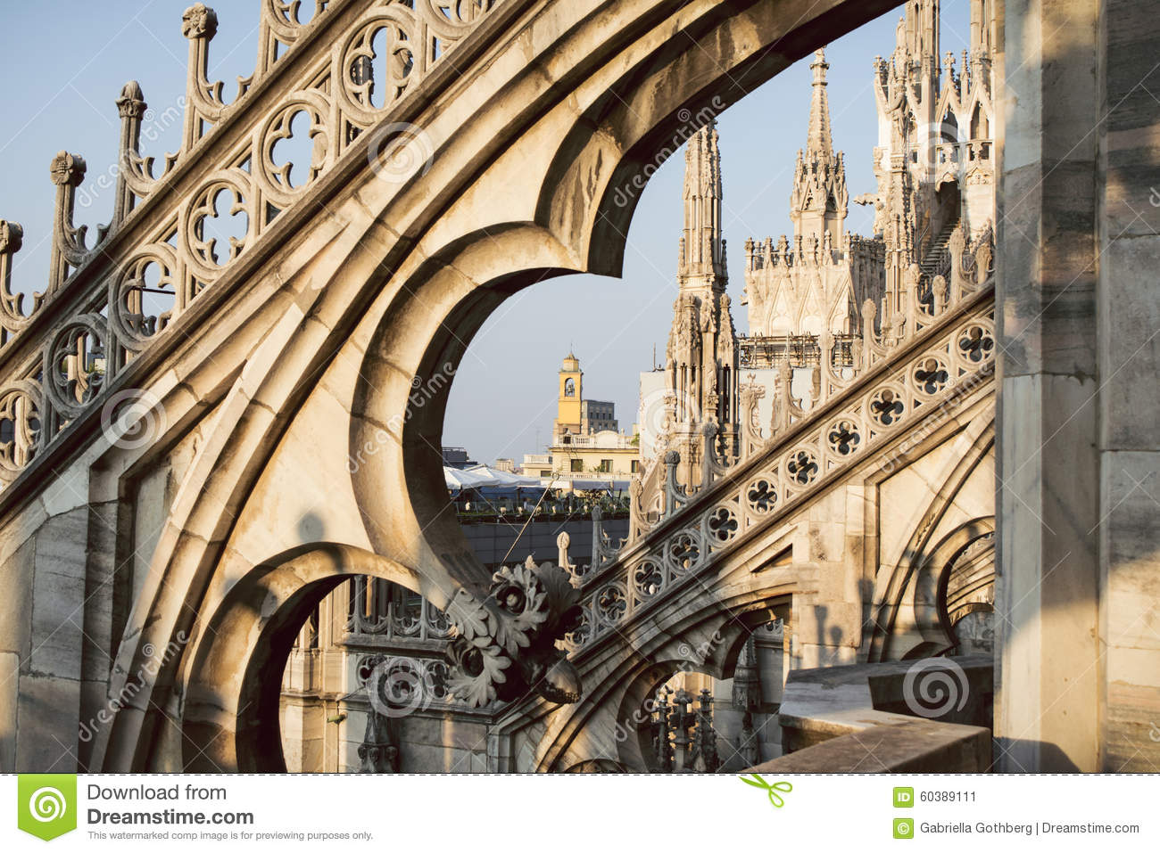 View through the arches and spires of the gothic cathedral Duomo di Milano, Italy.