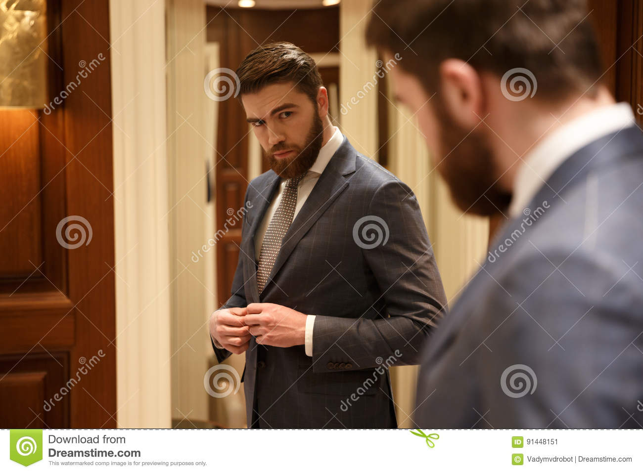 view from back of handsome man looking at the mirror stock image