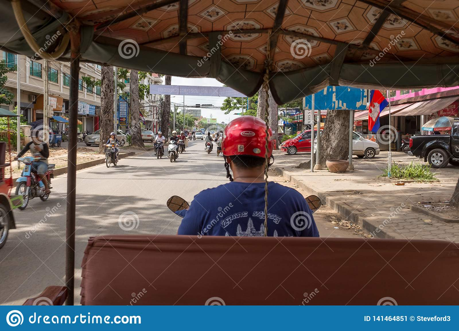The view from the back of tuk tuk as it weaves through the busy streets of Siem Reap, Cambodia