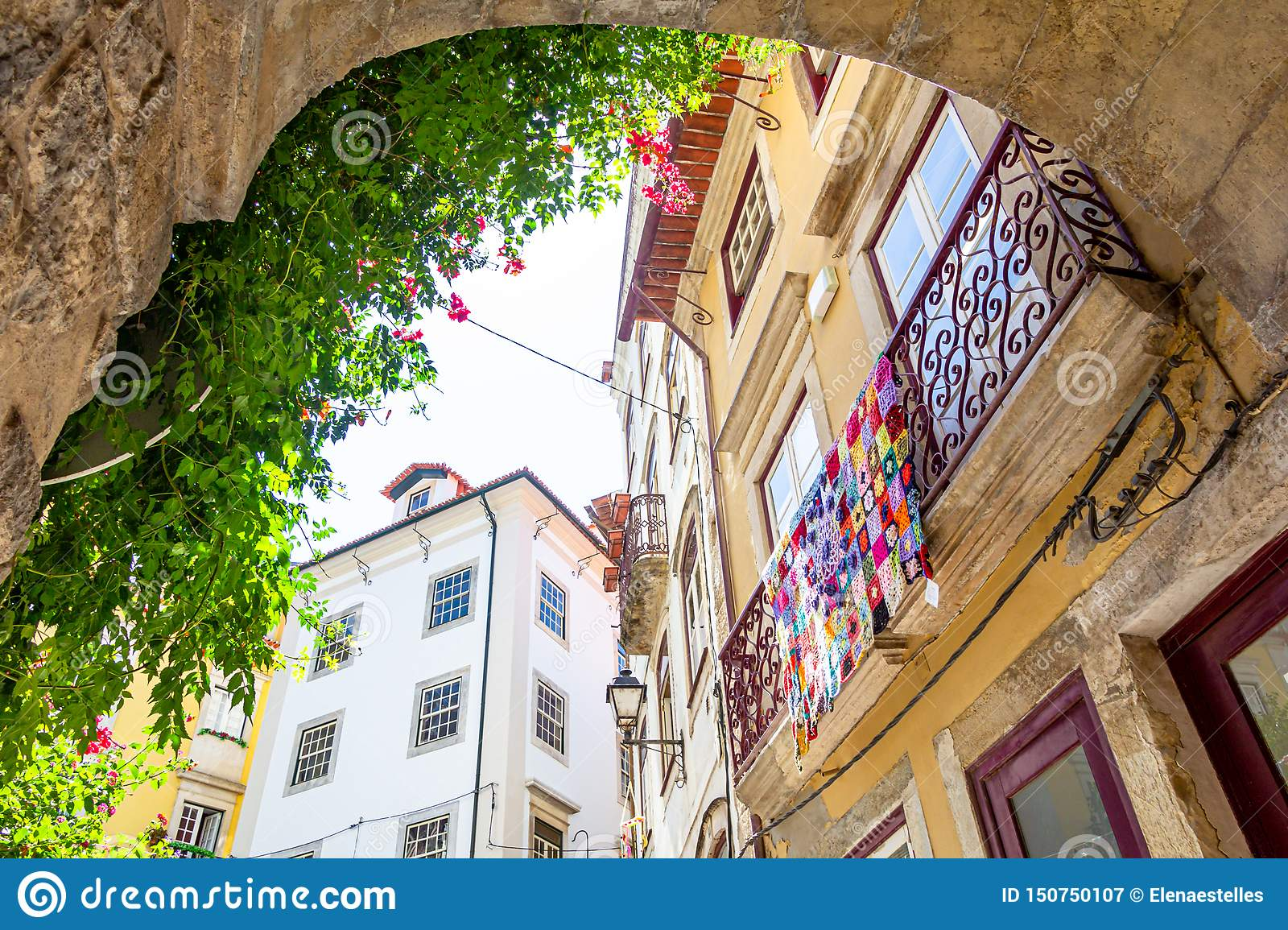 View on a balcony with colorful crochet blanket in Coimbra