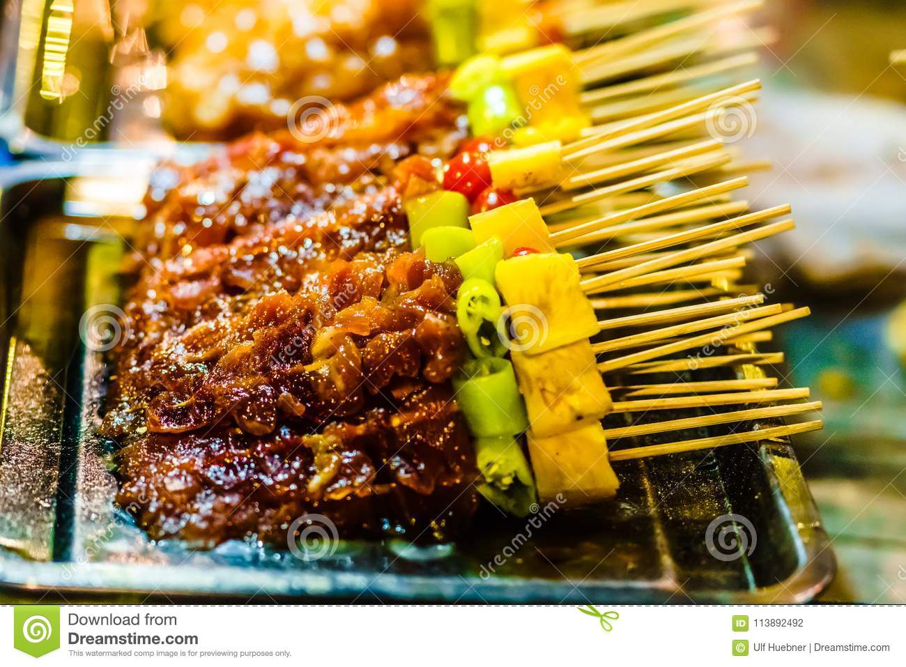 Barbecue on food market in Chiang Rai - Thailand