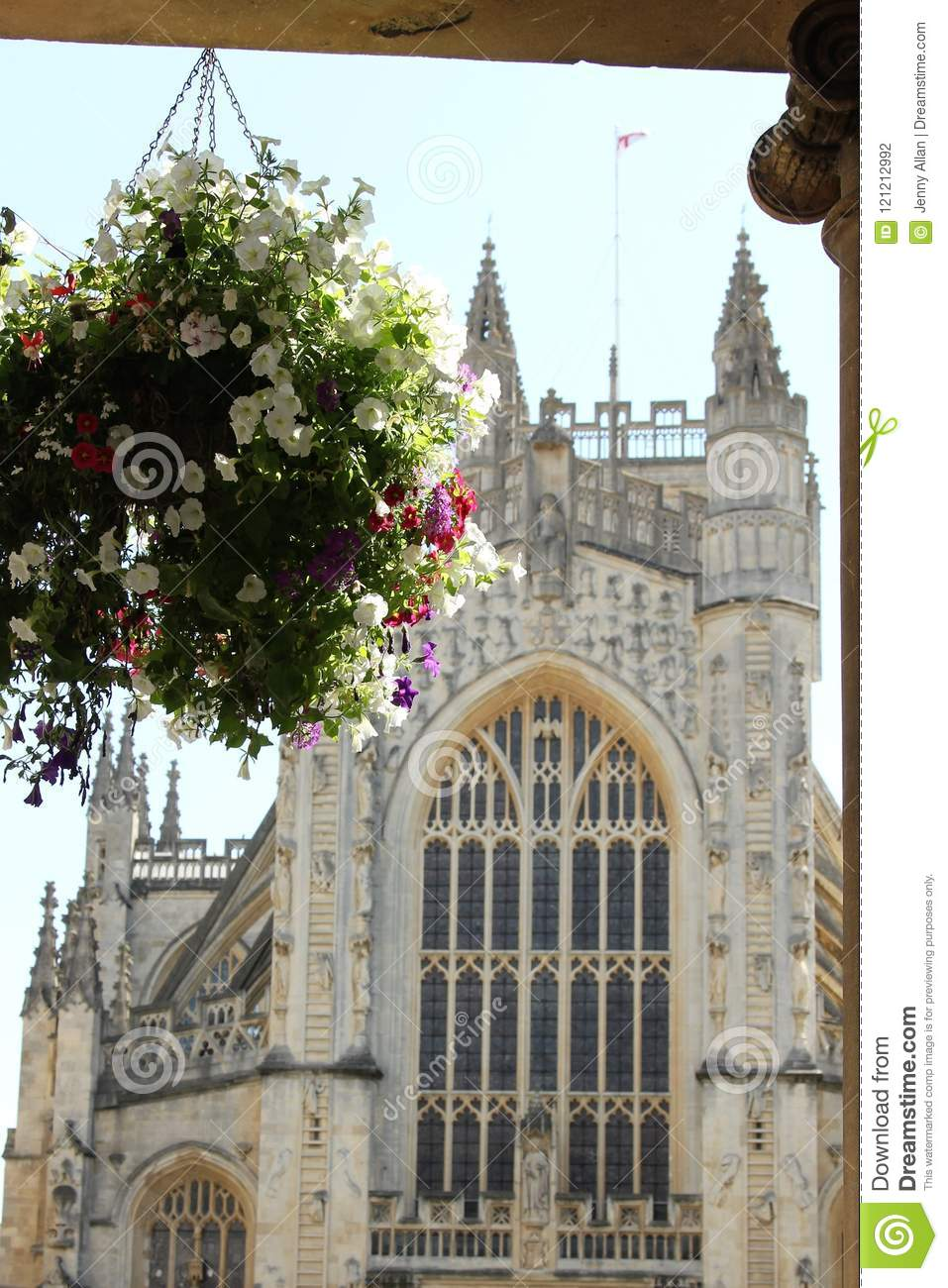 534e388296bc View of Bath Abbey with hanging basket of flowers, Bath, England. More  similar stock images