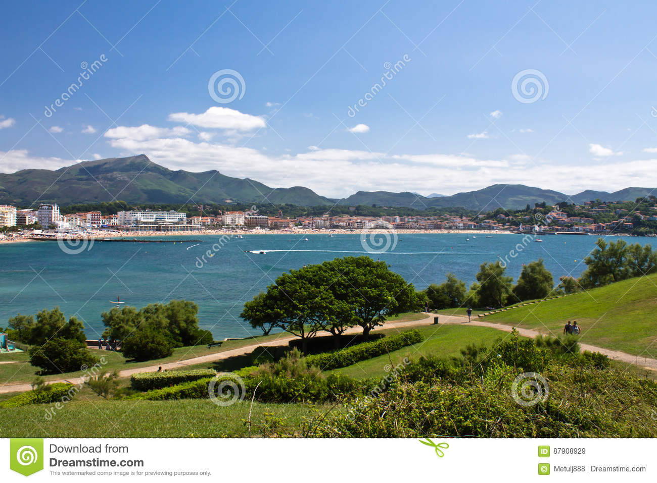 view on bay of colorful saint jean de luz with mountain la rhune in blue sky