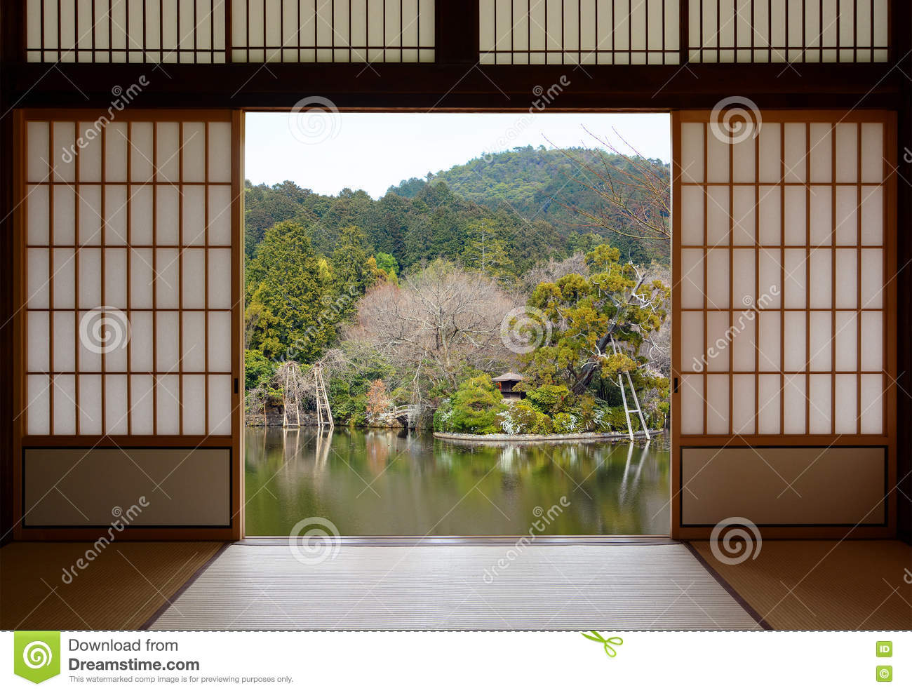 View Of A Beautiful Oriental Pond Seen Through Open Japanese Sliding