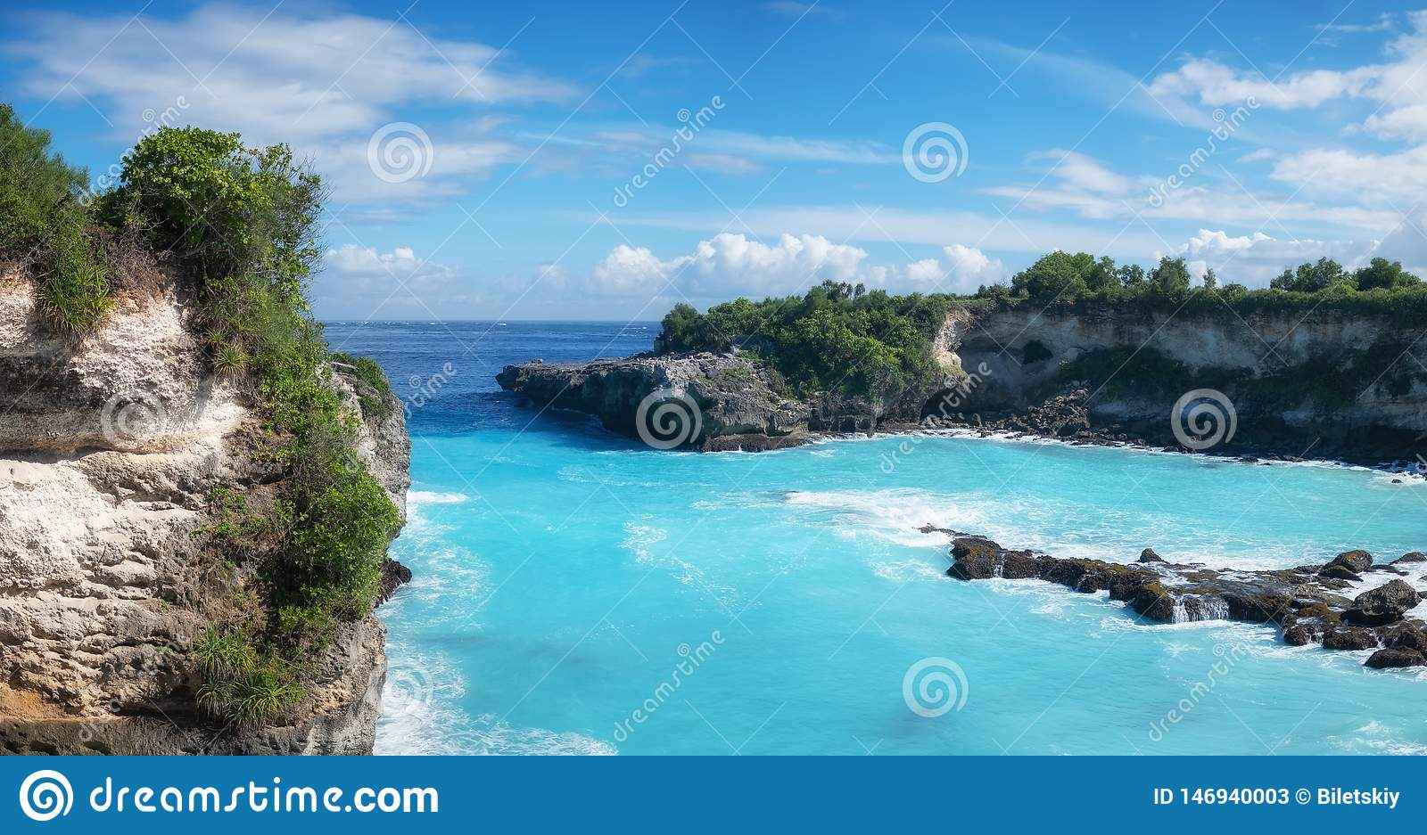 View on the blue lagune. Turquoise water background. Summer seascape from air. Rocks and azure sea water. Summer adventure.