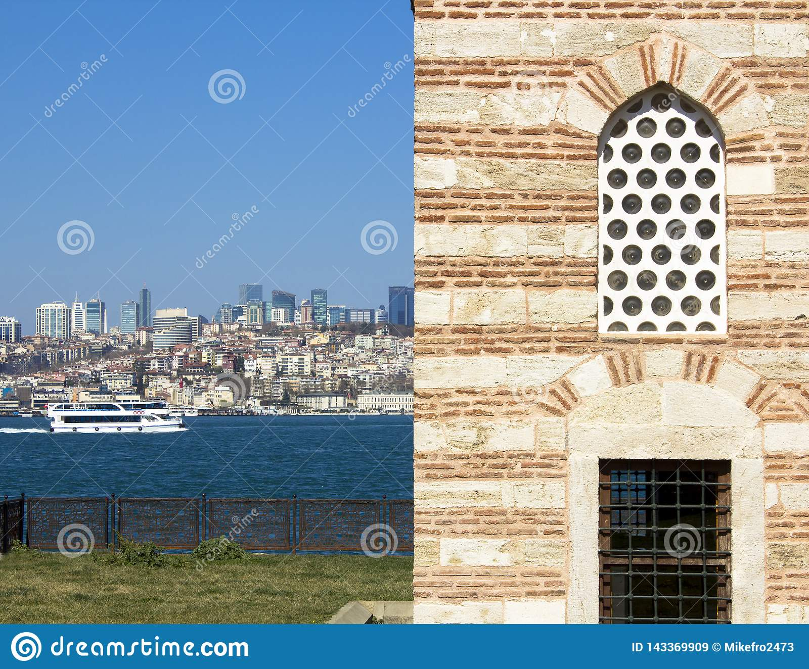 View of Bosphorus. Tourist ships and cargo barges sailing through it. View of Istanbul ancient buildings