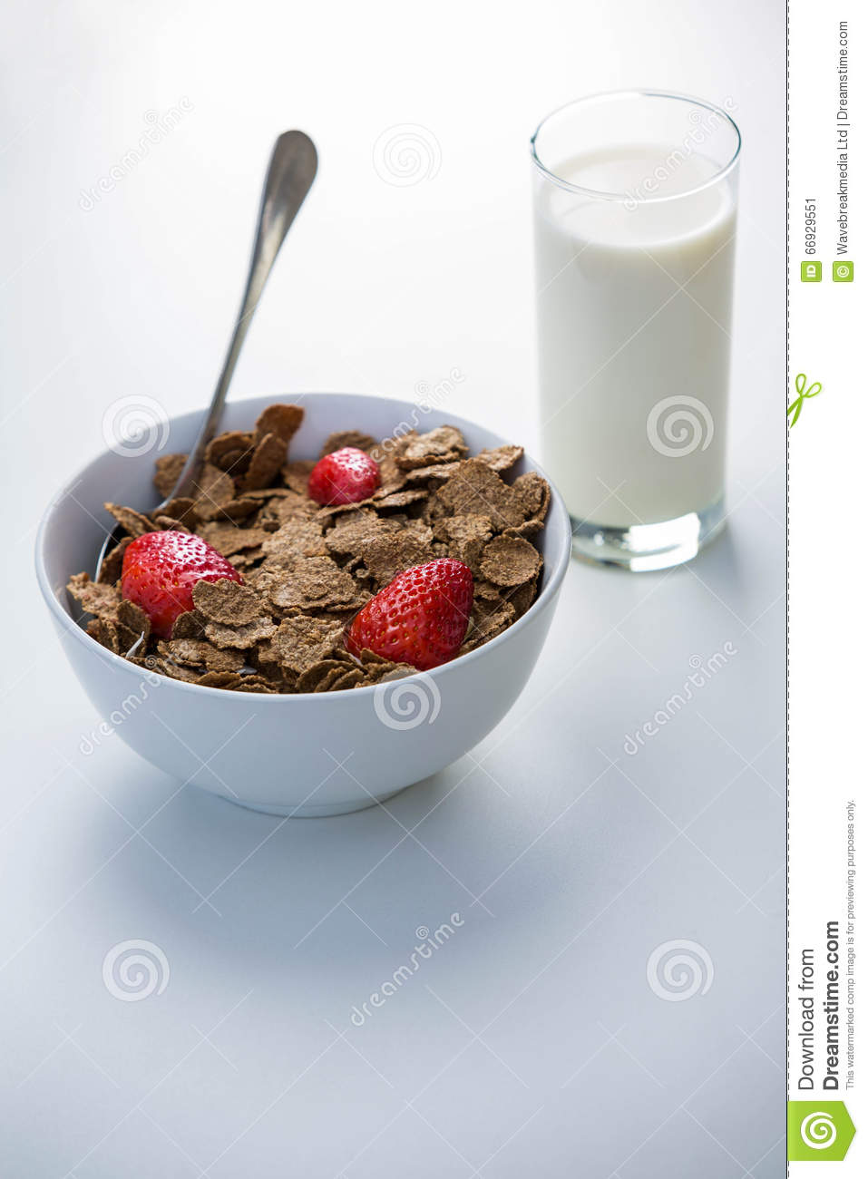 View of a bowl of cereals and glass of milk