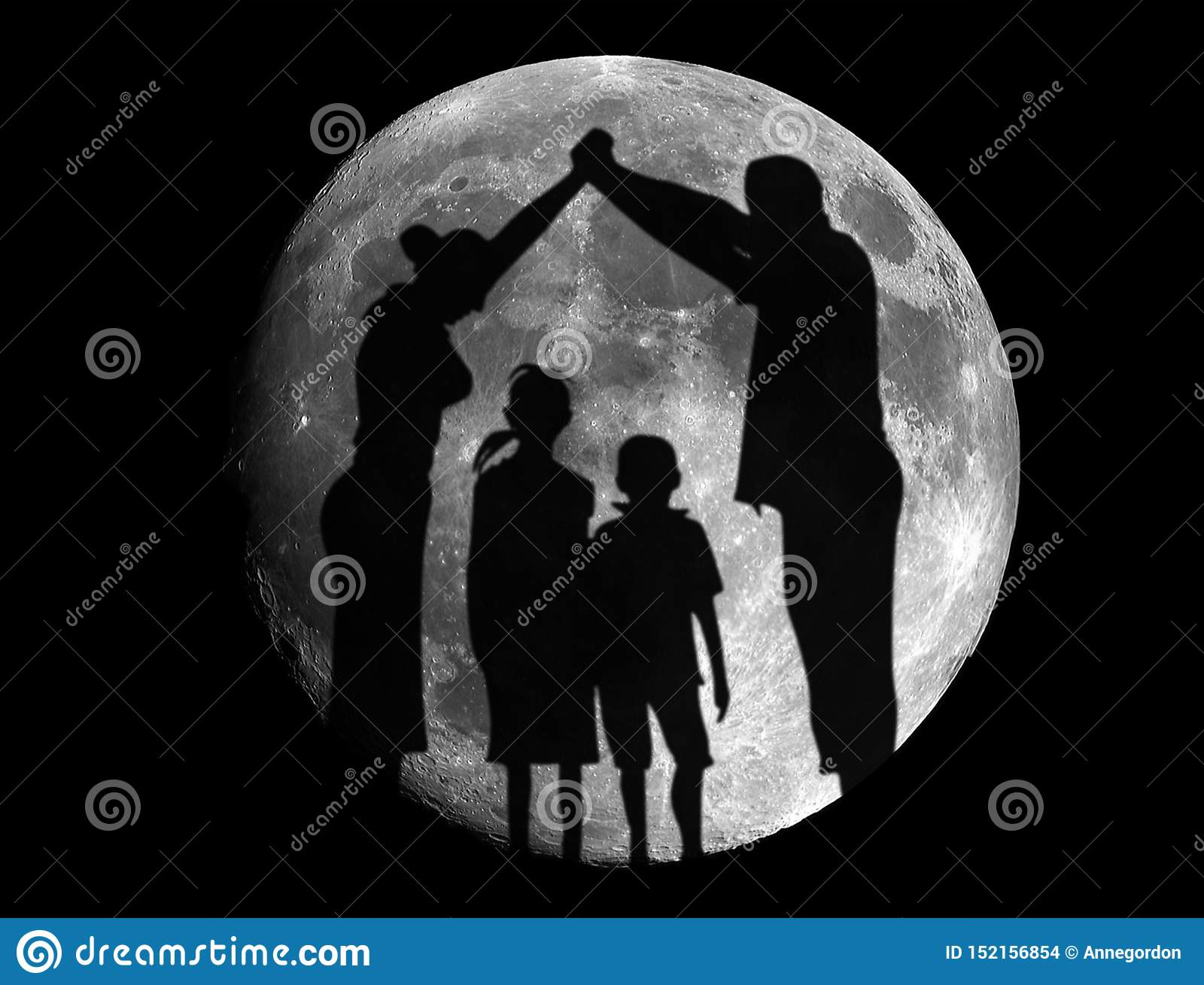 View of carefree family having fun in Moon Eclipse