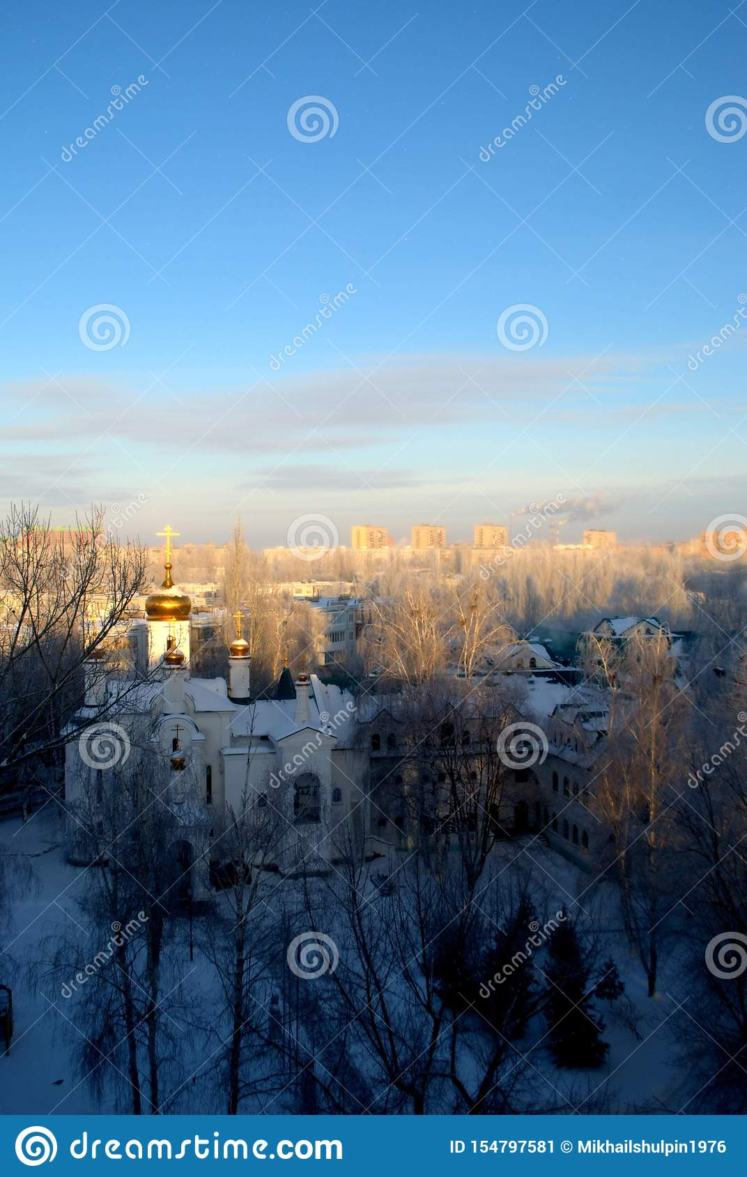 View of the Church in the name of All Saints in the Russian land shone on an early frosty morning.