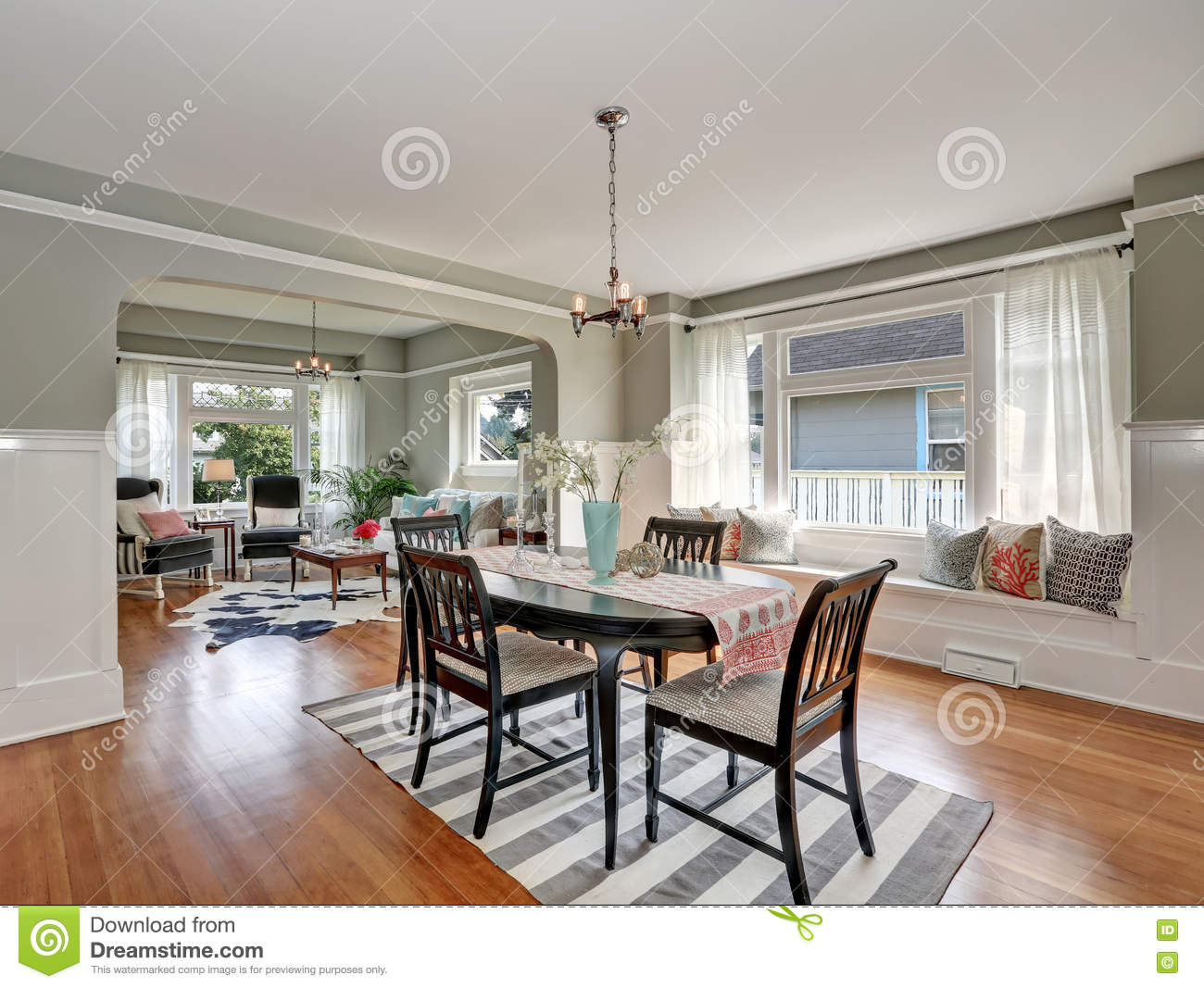 View Of A Classic Dining Room With Gray Walls And Hardwood ...