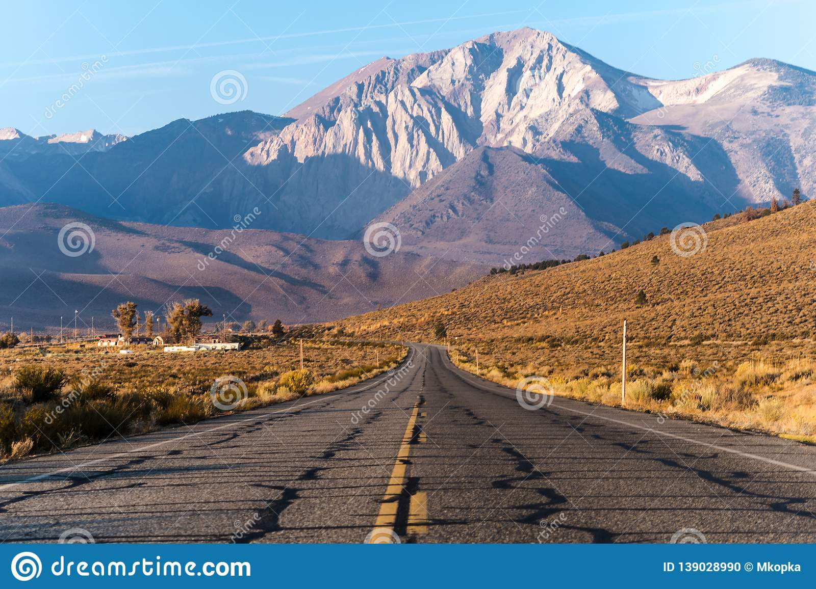 View Of The Eastern Sierra Nevada Mountain Range In California Taken In The Middle Of An Open Road Highway On A Sunny Autumn Stock Photo Image Of Sunny Taken 139028990