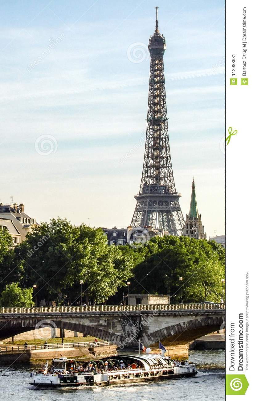 View on Eiffel Tower, Pont de la Concorde and cruise ship on Seine river in Paris in France