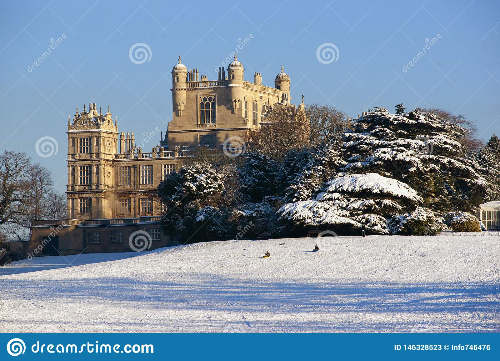 A view of the Elizabethan Wollaton Hall museum and gardens in the snow in winter in Nottingham, Nottinghamshire taken 3rd December