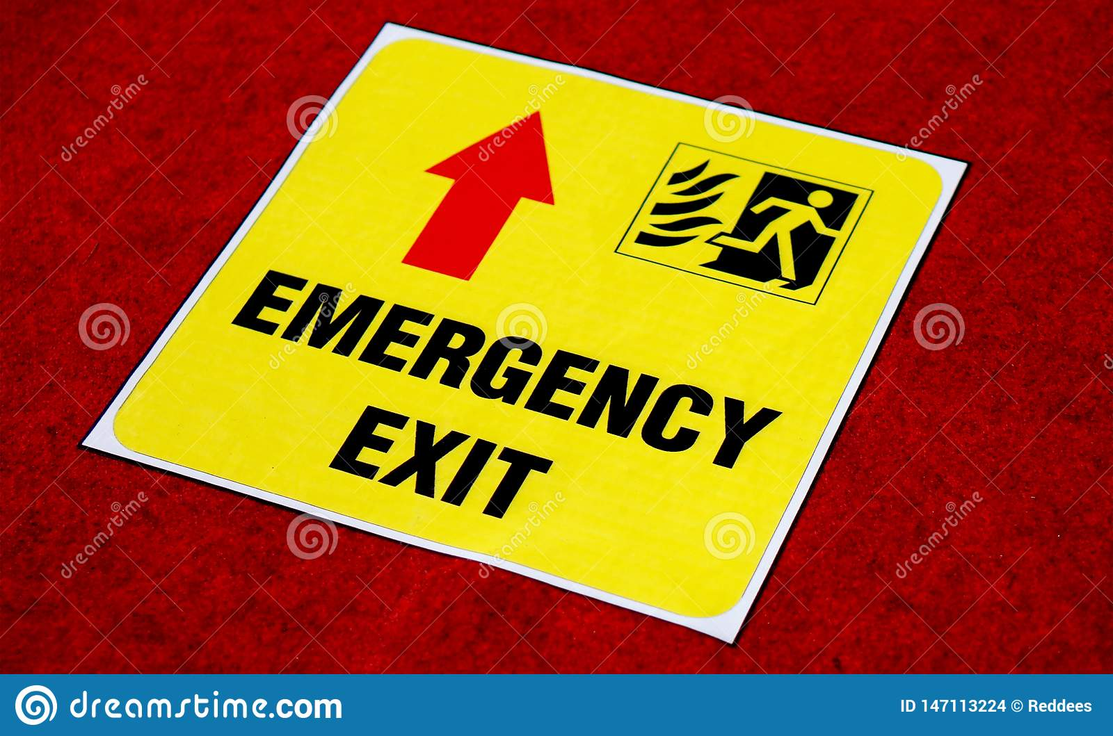 View of Emergency exit way sign sticker on the floor in a public place