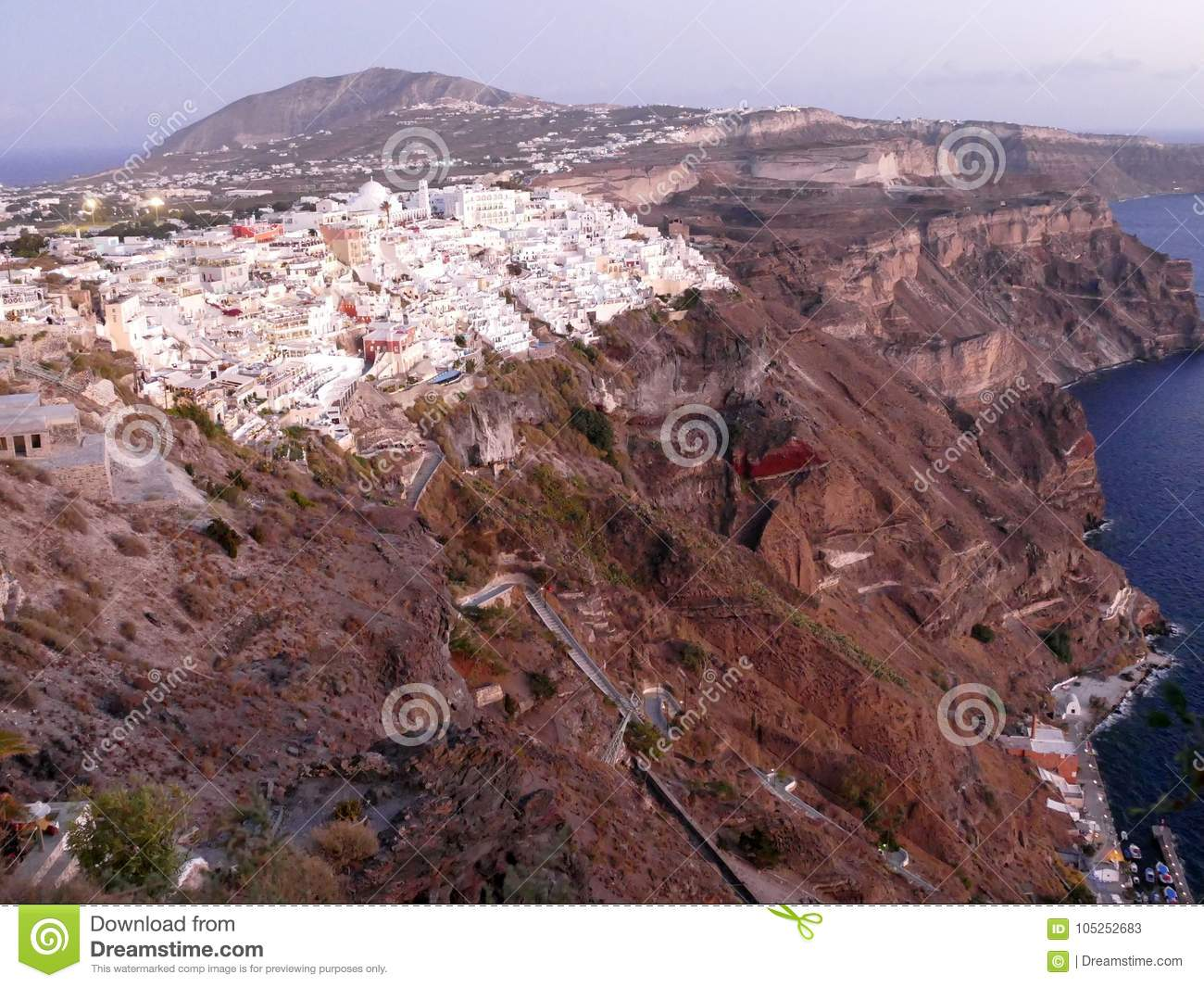 View of Fira in Santorini at sunset, viewed from above