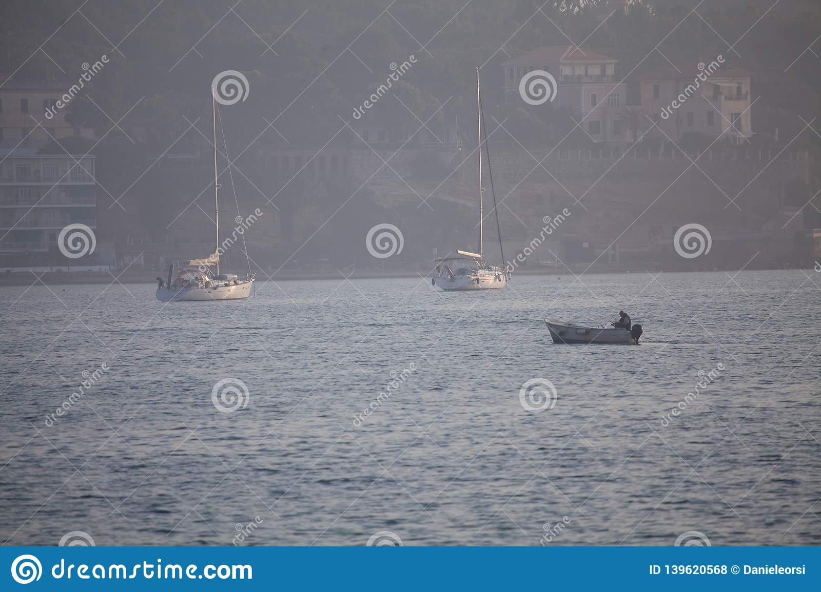 A view of a fishing net inside of the boat in the sea. Beautiful calm sea and water during an hot summer day