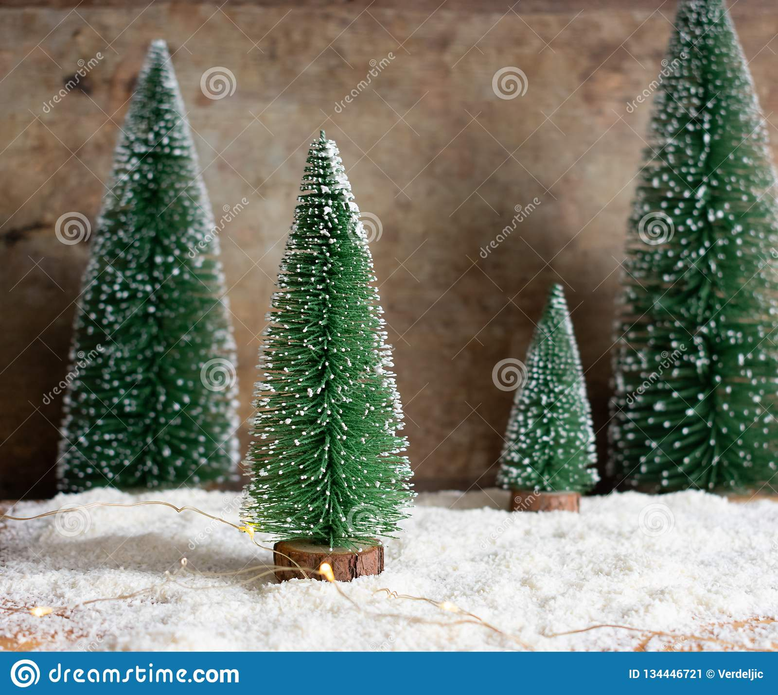 Green Snowy Christmas Trees Decoration And Lights On Wooden Background Stock Image Image Of Composition Close 134446721