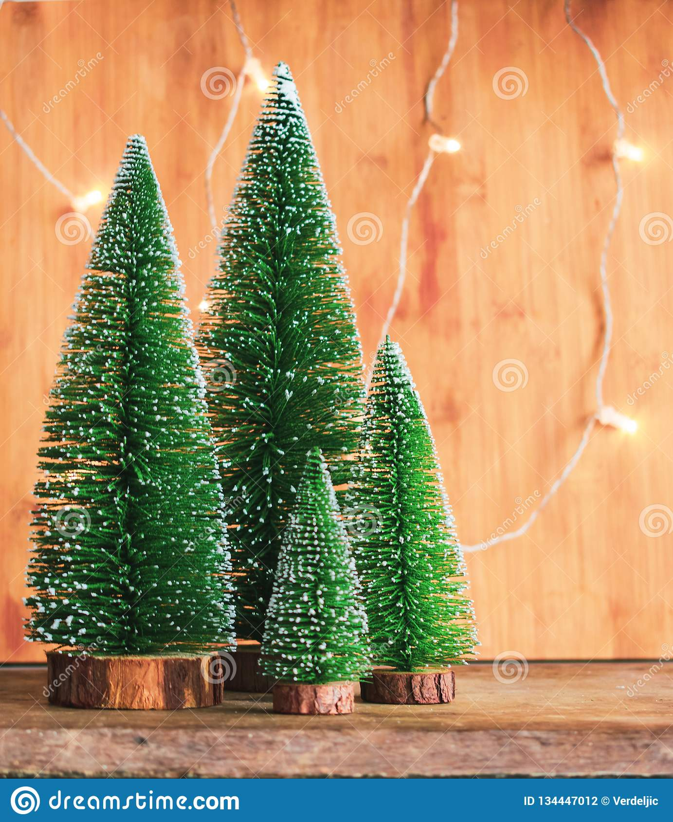 Green Snowy Christmas Trees Decoration And Lights On Wooden Background Stock Photo Image Of Happy Rustic 134447012