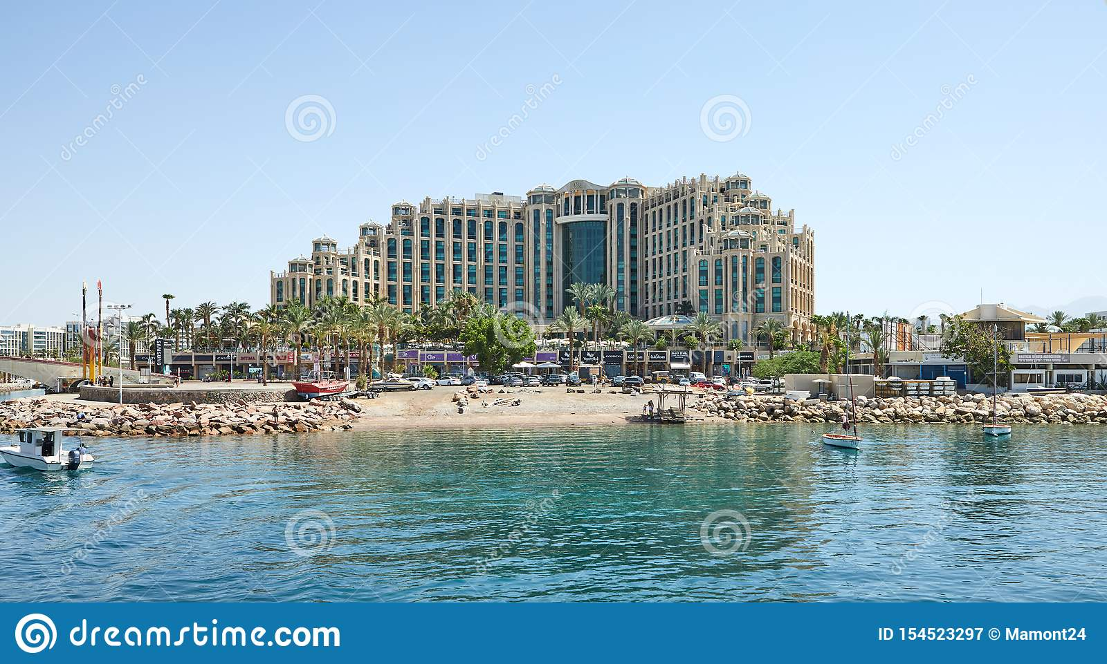 View of the Gulf of Eilat with luxury yachts. Hotels for tourists boats and yachts for a holiday