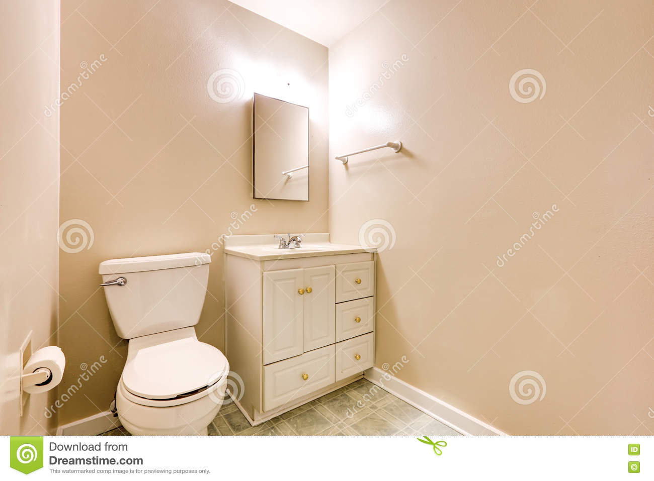 view of half bathroom with beige walls and tile floor stock image