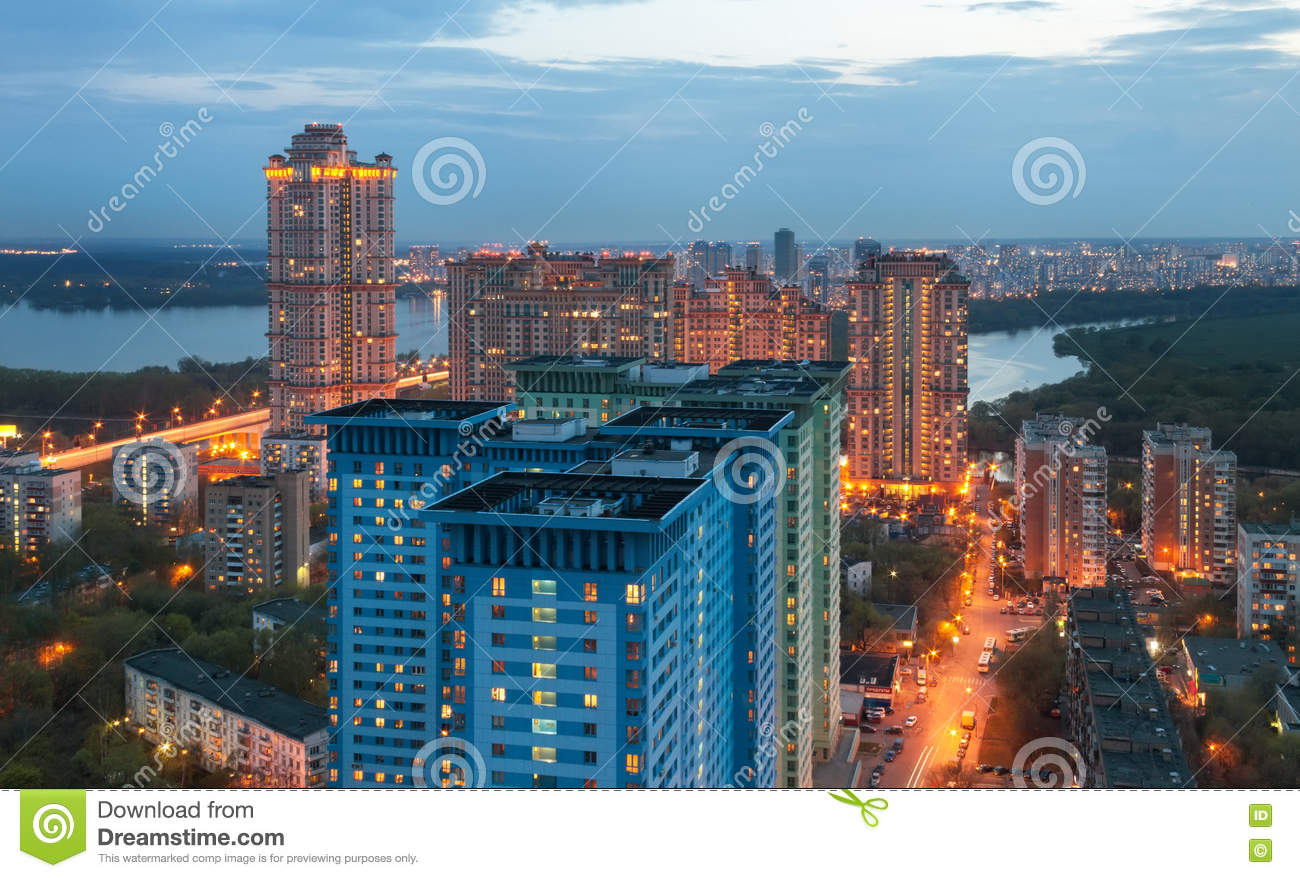 The view from the height on high-rise building on the outskirts of Moscow, in the twilight on the background of the river.