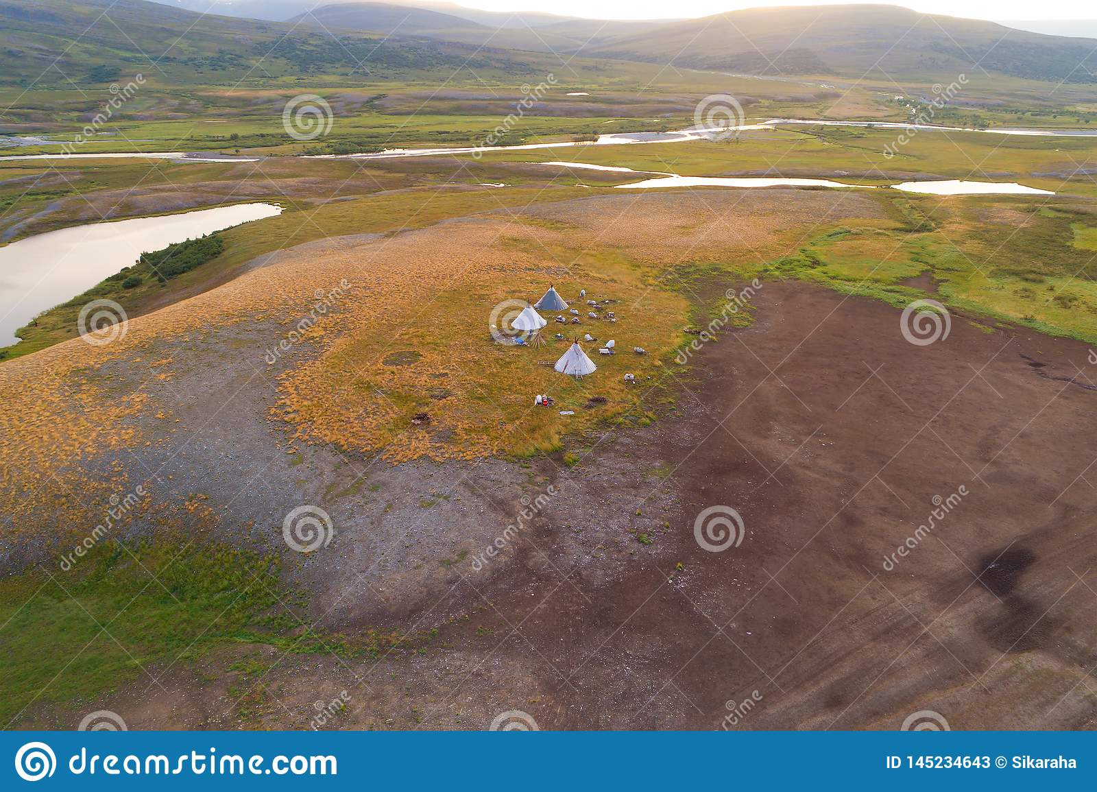 View from height on a settlement of nomads reindeer breeders in the valley of the Longotjyogan River aerial photography.