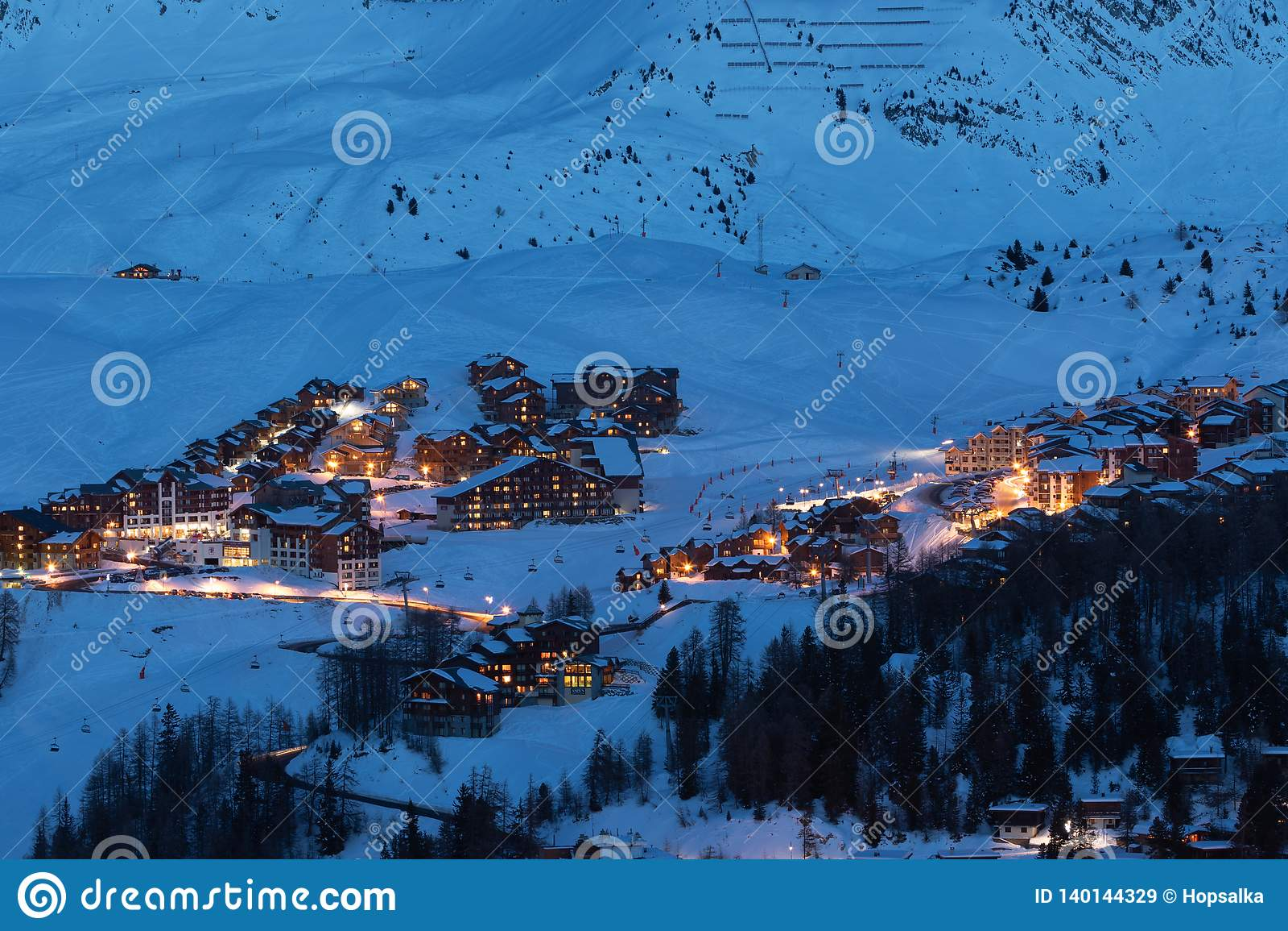 View of high altitude ski resorts in French Savoy Alps in twilight: Plagne Centre, Plagne Soleil and Plagne Village