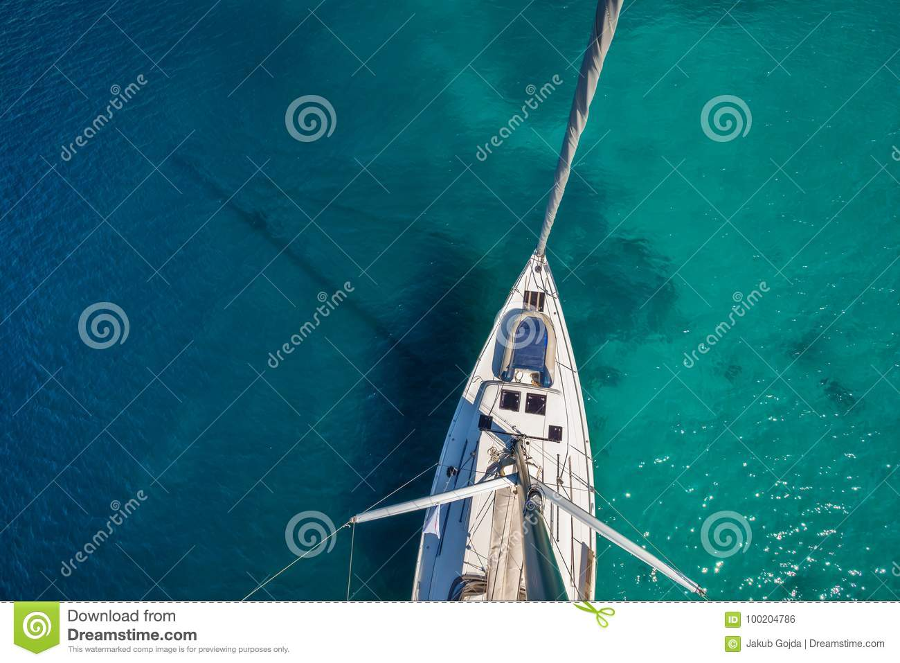 View from high angle of sailing boat. Aerial photography of ship