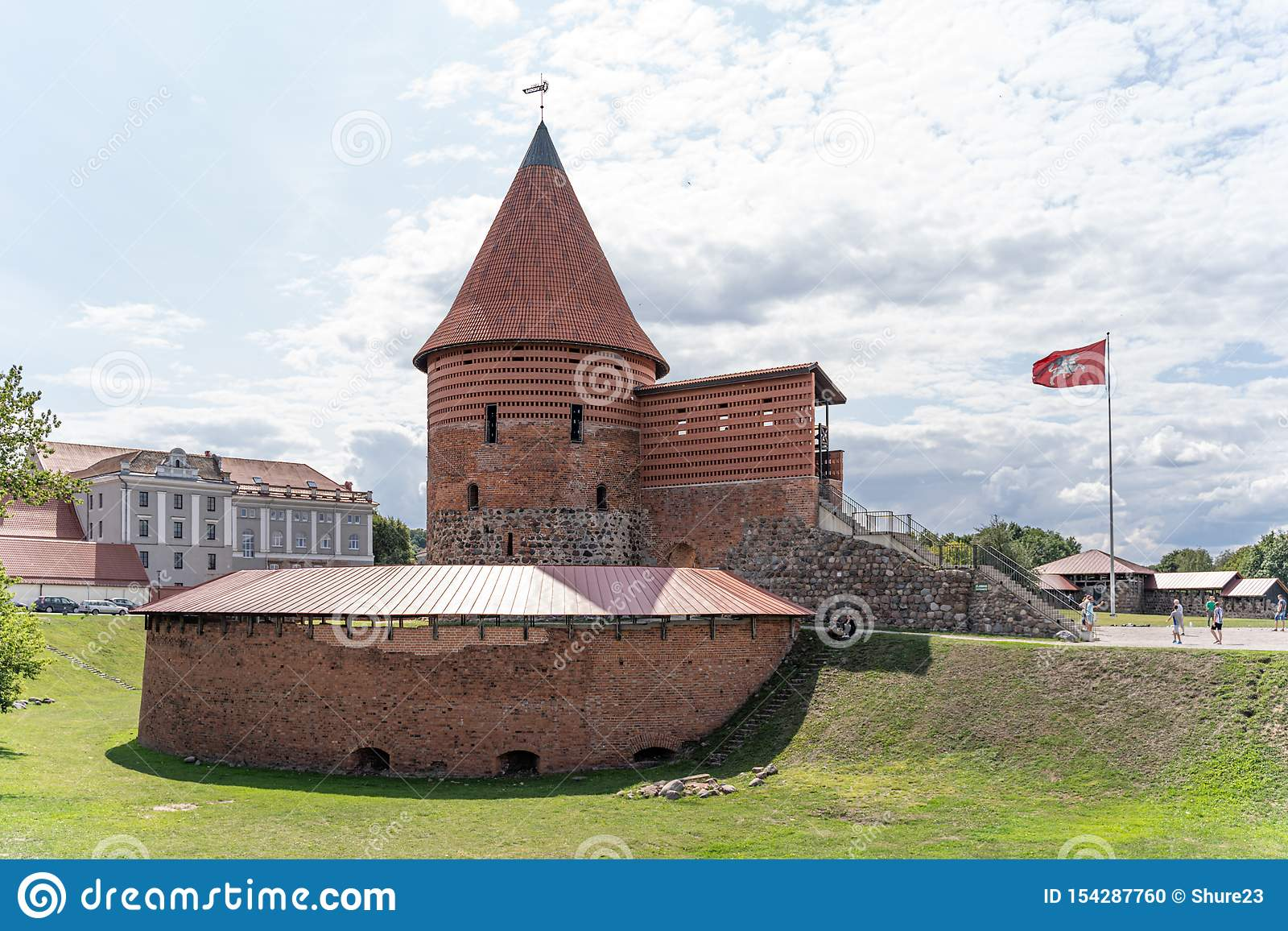 View of historical gothic Kaunas Castle from medieval times in Kaunas, Lithuania. On beautiful blue sky background. Old castle in