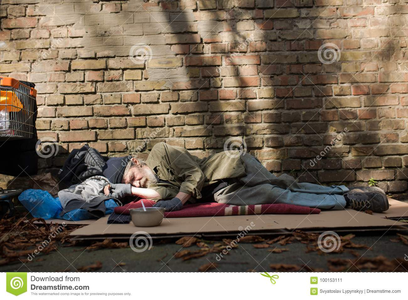 e90f49340f View Of Homeless Man Sleeping On Cardboard On The Ground. Stock ...