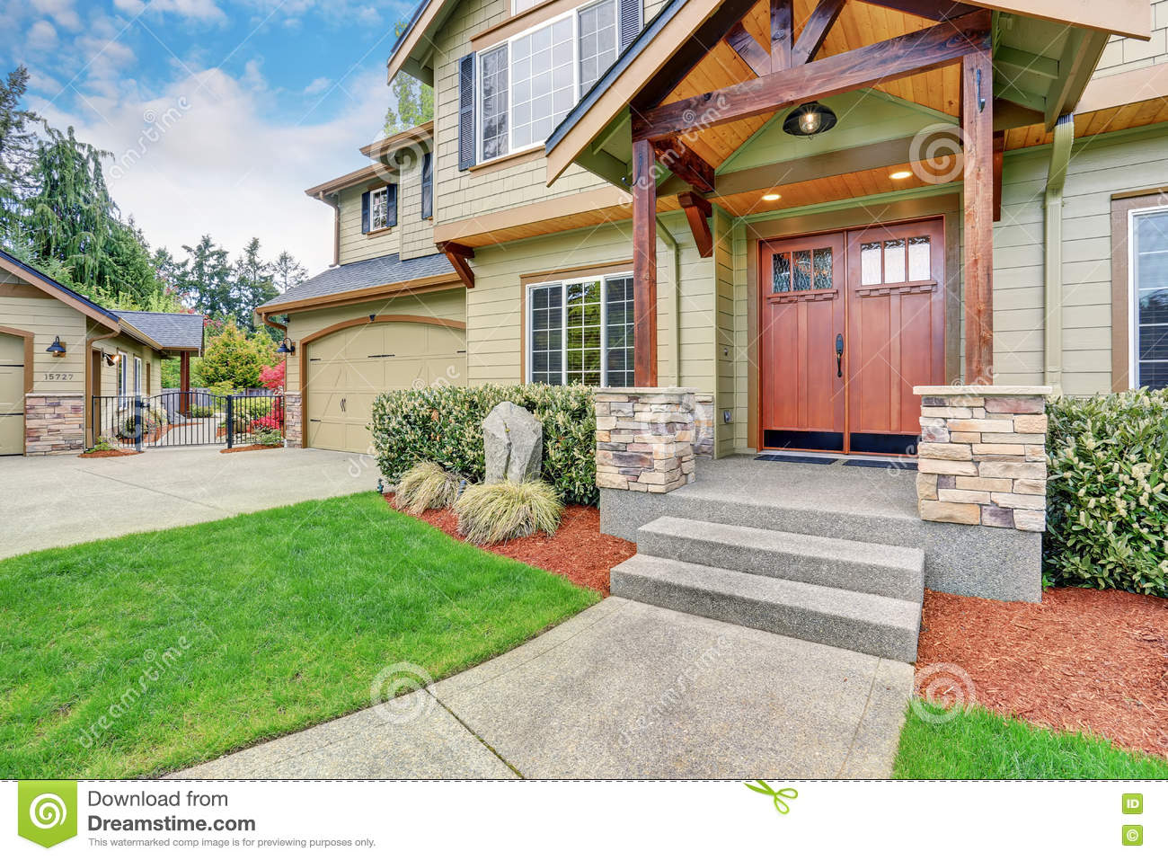View of house entrance with stone column trim and double doors