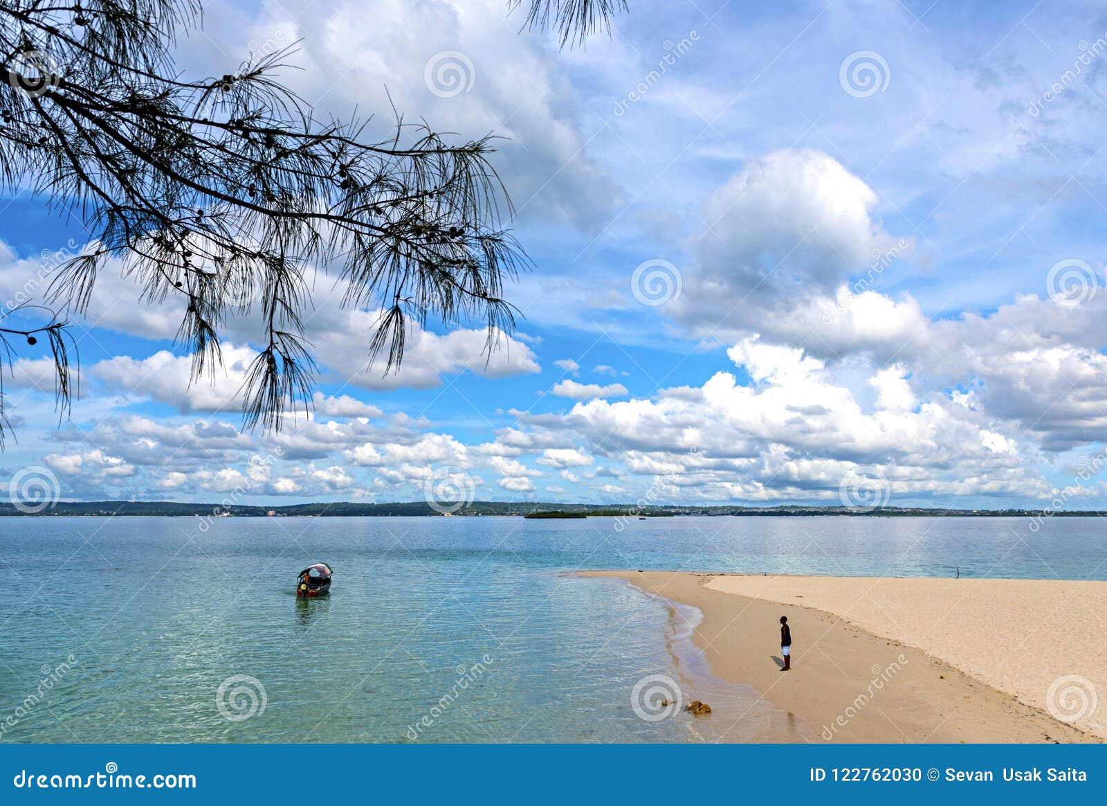 View of the Indian ocean. Traditional dhow boat on the water near beautiful beach of island Zanzibar. Tanzania