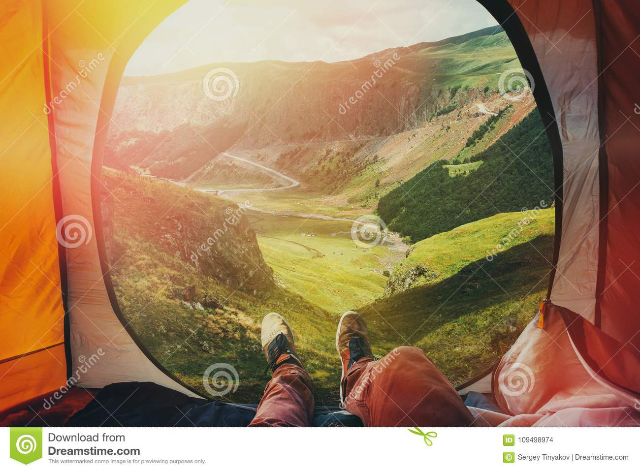 View from inside a tent on the mountains in Elbrus, Point Of View Shot. Travel Destination Hiking Adventure Concept