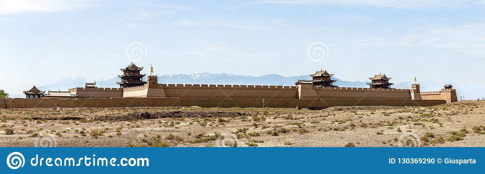 View of Jiayuguan Fort with snow capped mountains on the backgrond, Gansu, China