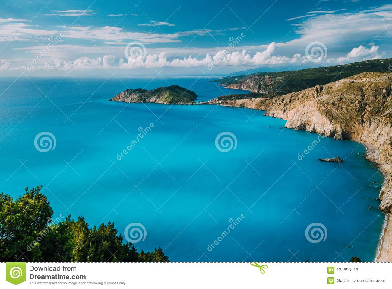 View of Kefalonia west coastline. Assos village town and Frourio peninsular. Beautiful milky blue bay with brown rocky