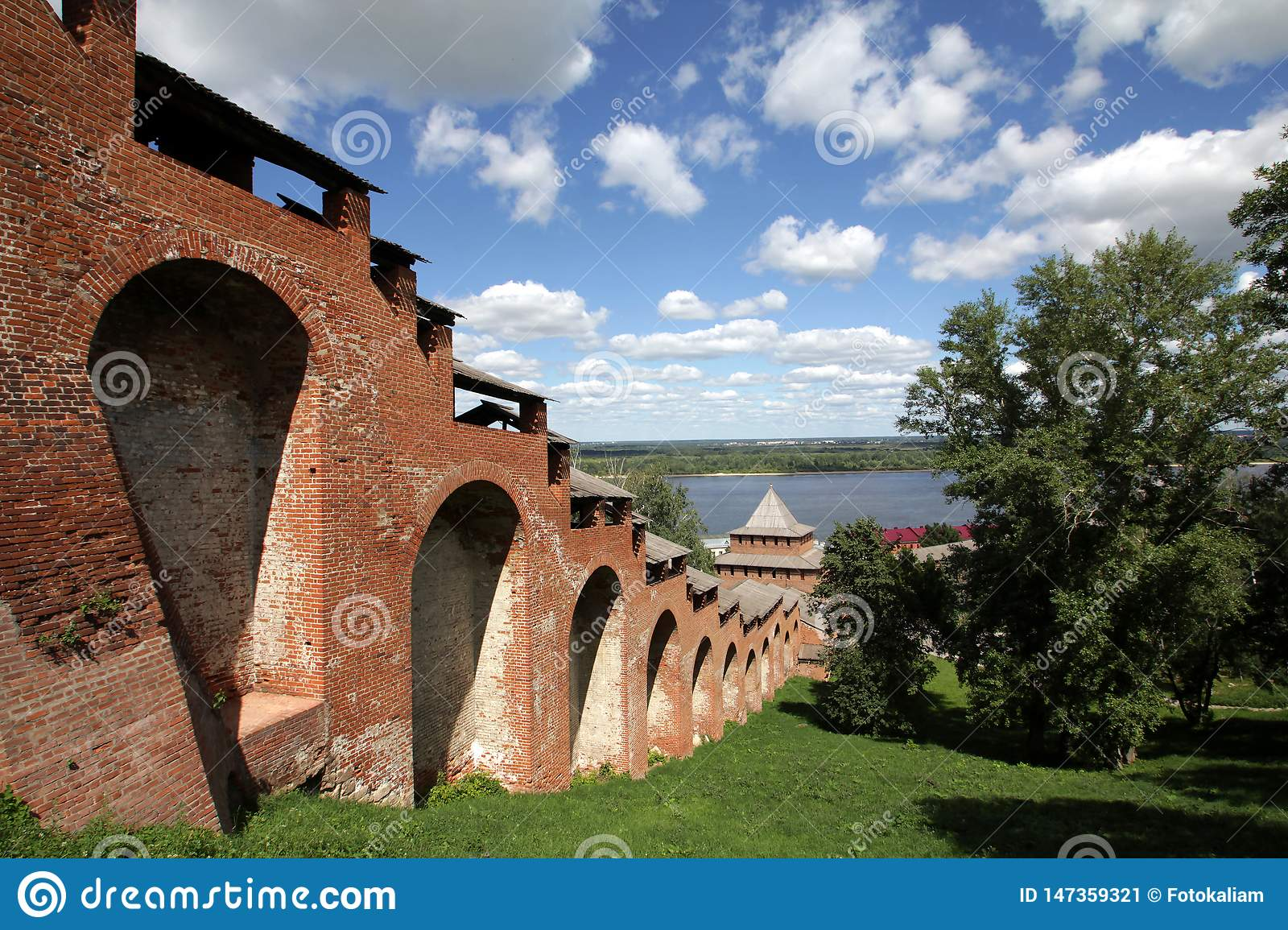 View of Kremlin walls under the blue sky with beautiful white clouds